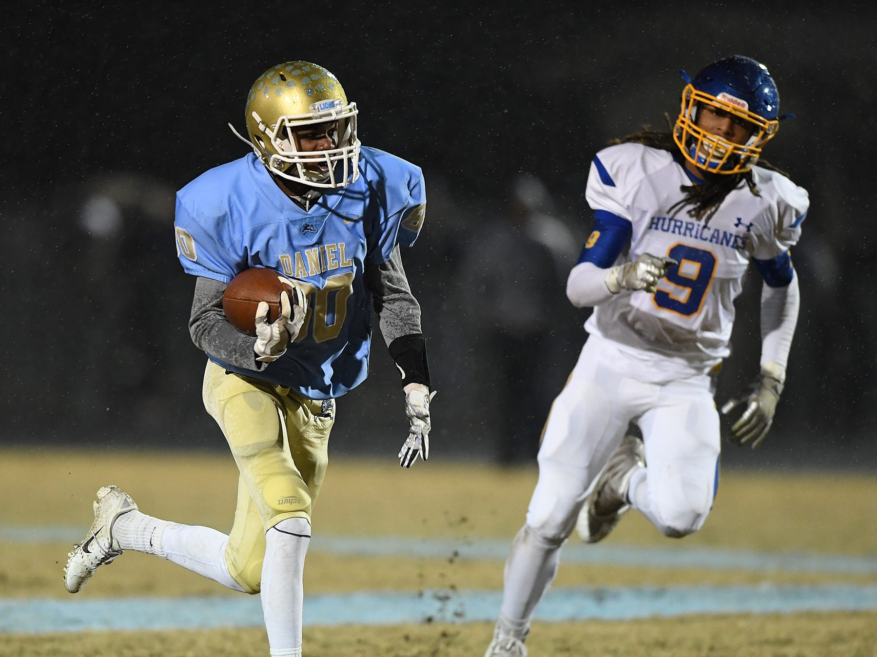 Daniel's Hack Hamilton (80) carries against Wren during the third round of the class AAAA playoffs Friday, November 23, 2018, at Daniel High in Central.