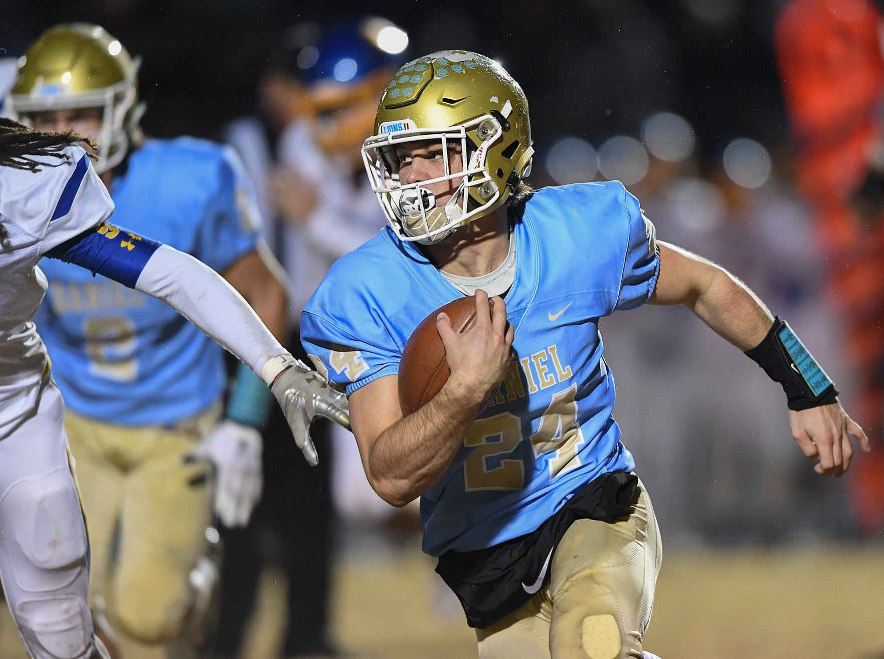Daniel quarterback Tyler Venables (24) carries against Wren during the third round of the class AAAA playoffs Friday, November 23, 2018, at Daniel High in Central.