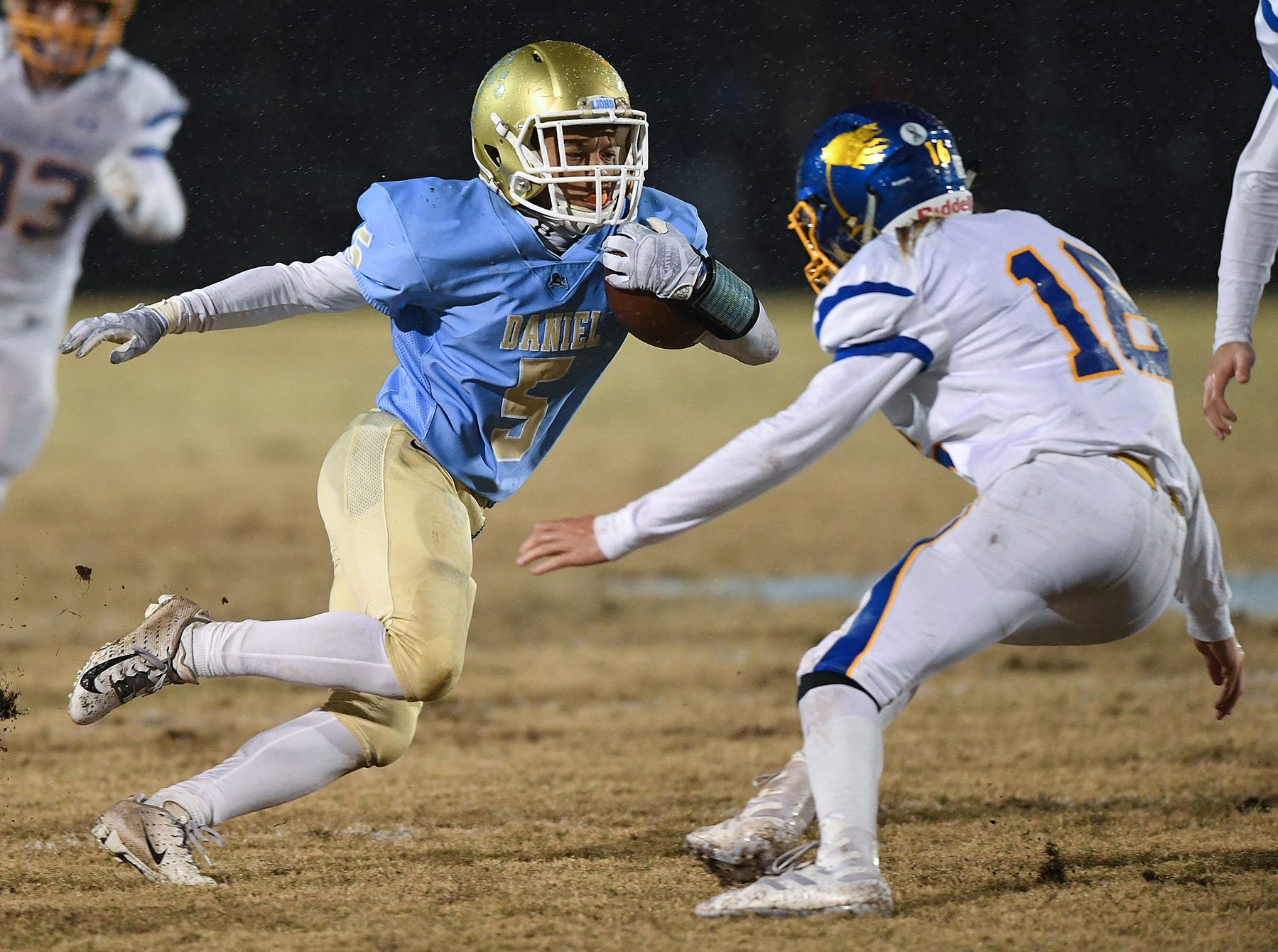 Daniel's Kiandre Sims (5) carries against Wren during the third round of the class AAAA playoffs Friday, November 23, 2018, at Daniel High in Central.