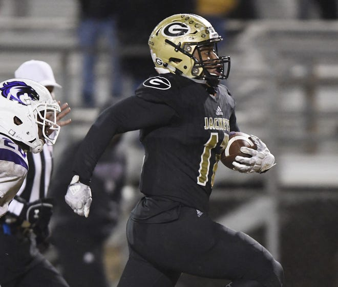 Greer's Jakyre Kerns (12) returns a Ridge View interception in the third round of the Class AAAA playoffs Friday, November 23, 2018 at Greer's Dooley Field.