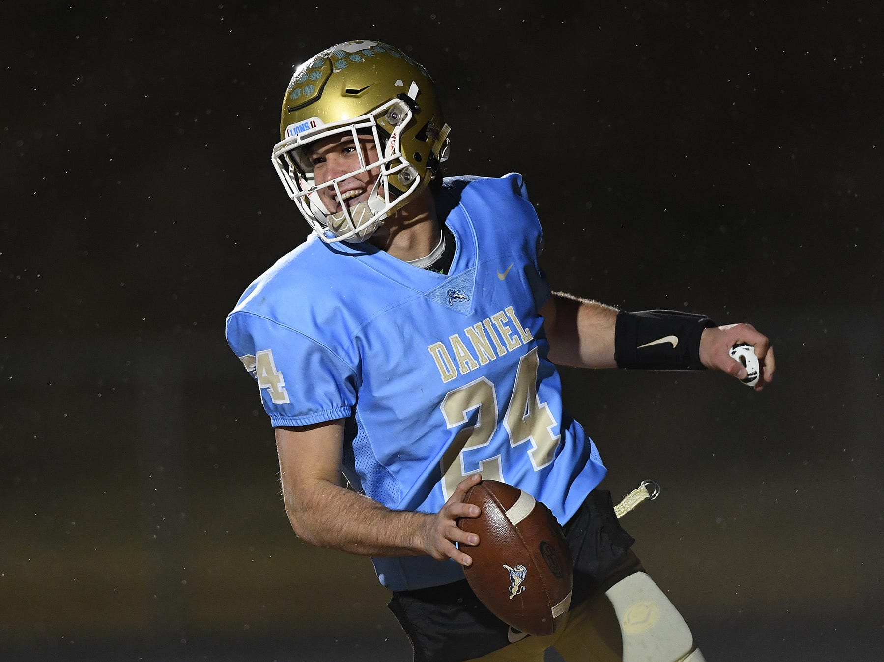 Daniel quarterback Tyler Venables (24) scores against Wren during the third round of the class AAAA playoffs Friday, November 23, 2018, at Daniel High in Central.
