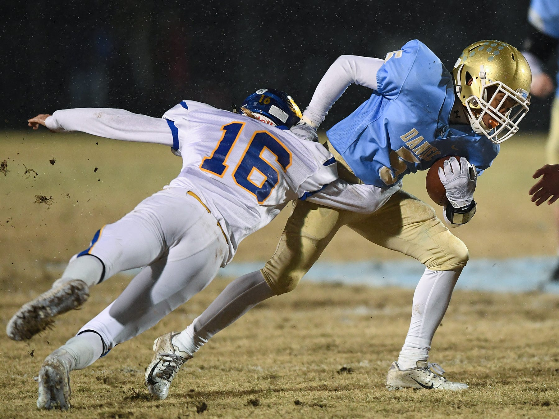 Wren's Nick Morgan (16) tries to stop Daniel's Kiandre Sims (5) during the third round of the class AAAA playoffs Friday, November 23, 2018, at Daniel High in Central.