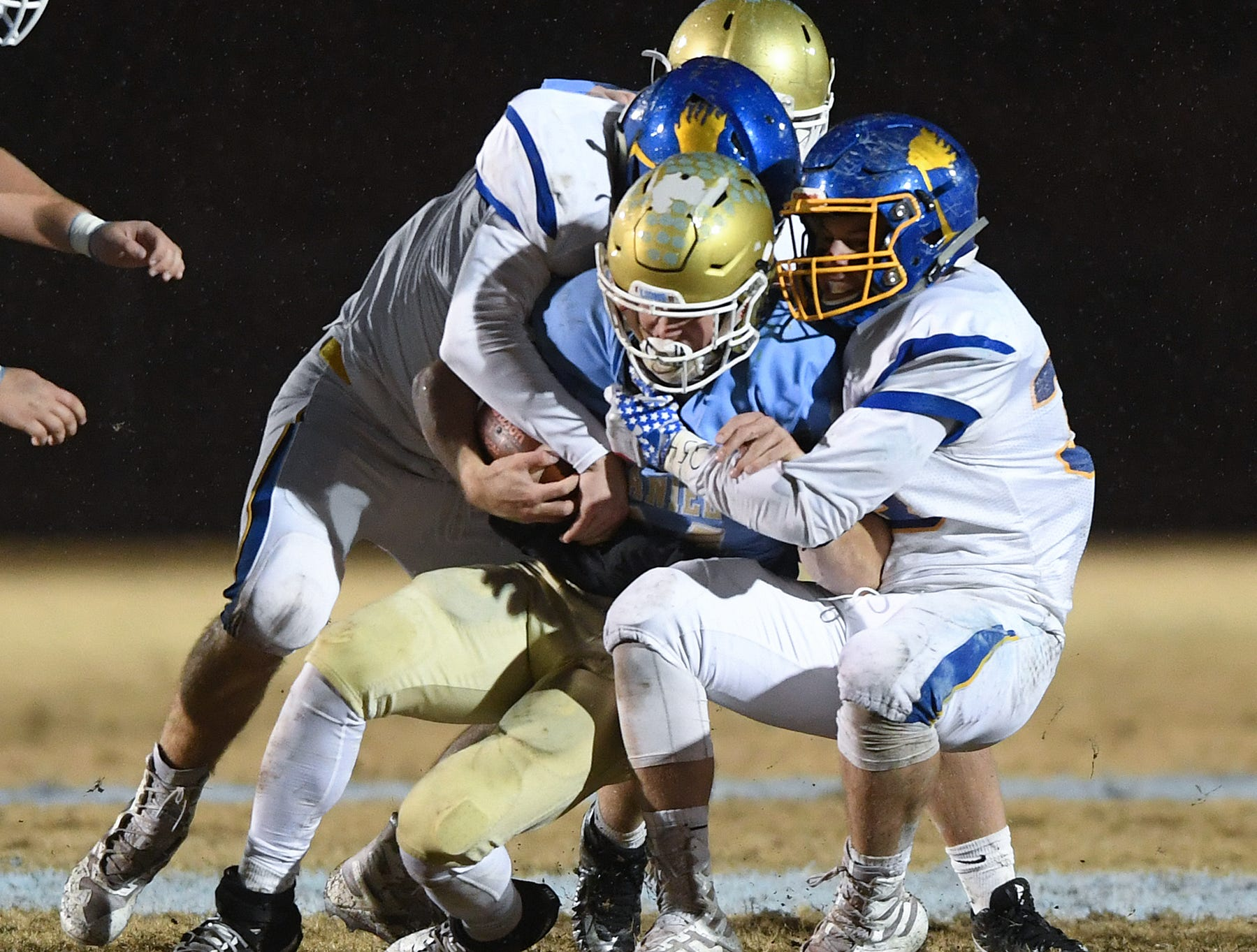 Daniel quarterback Tyler Venables (24) is brought down by the Wren defense during the third round of the class AAAA playoffs Friday, November 23, 2018, at Daniel High in Central.