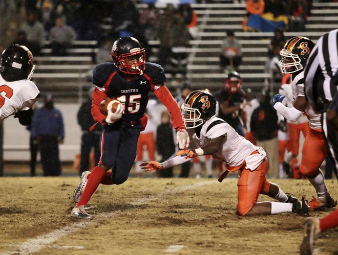Chester's Emmanuel Wright (15) carries the ball against as Southside's Adrian Smith tries to make the tackle during Chester's 48-20 victory in the third round of the Class AAA playoffs Friday night.