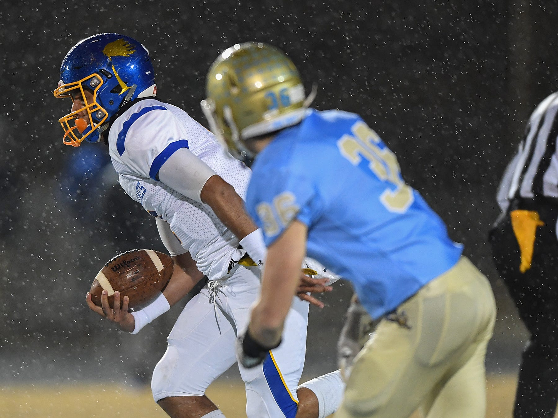 Wren quarterback Tyrell Jackson (1)  carries against Daniel during the third round of the class AAAA playoffs Friday, November 23, 2018, at Daniel High in Central.