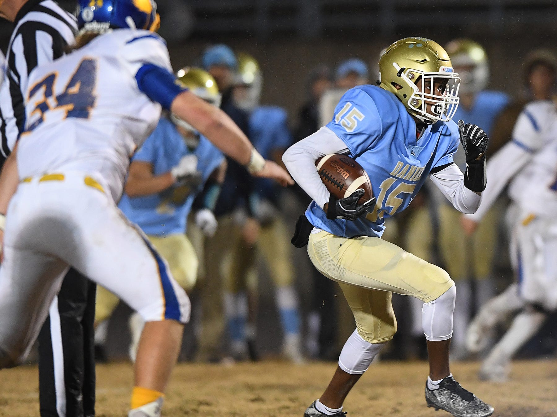 Daniel's Billy Bruce (15) carries against Wren during the third round of the class AAAA playoffs Friday, November 23, 2018, at Daniel High in Central.