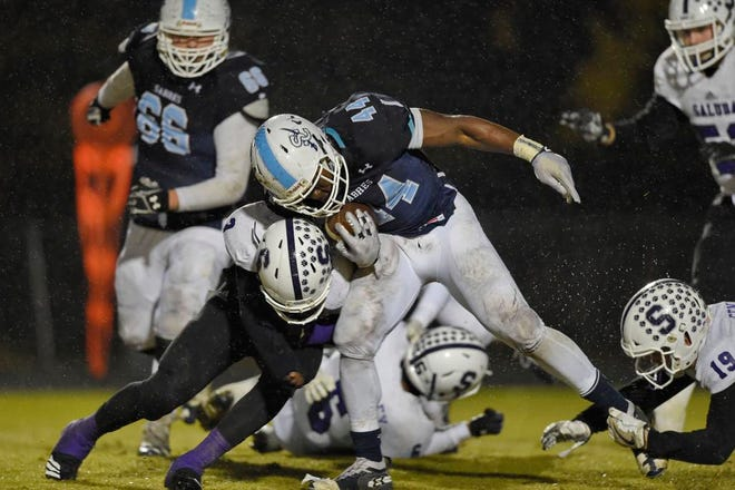 Southside Christian's Malory Pinkney plows through the Saluda defense for a first down. Southside Christian hosts Saluda in a third round football playoff game Friday.
