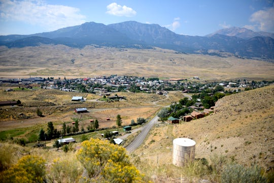 This Aug. 17, 2017 photo shows a view of Gardiner, Mont., the gateway town to Yellowstone National Park. Gardiner is struggling with housing affordability as home prices rise and owners turn rental properties into vacation rentals. The shift is contributing to a loss of students in the school district. (Rachel Leathe/Bozeman Daily Chronicle via AP)