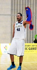 In this file photo,  Team Guam's Tai Wesley waves the Guam flag after making a 3-point shot to lift Guam over Fiji in men?s basketball July 8, 2015 at the Taurama Aquatics Center and Indoor Sports Complex. Guam won in overtime 75-72 at the 2015 Pacific Games in Port Moresby, Papua New Guinea and beat Fiji for the gold medal.