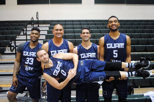 In this file photo is the winning team at the 2017 Guam 3X3 National Championship, comprised of five players who are, from left: Earnest Ross, Mekeli Wesley, Russ Wesley, Jonathan Galloway and in their arms, James Stake. Ross and the Wesley brothers will join Team Guam in Thailand.