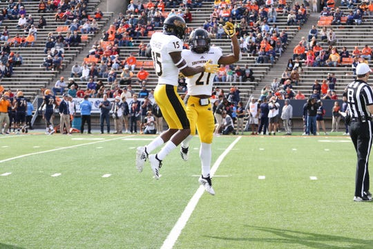Southern Miss defensive backs Shannon Showers (15) and Rachaun Mitchell (21) celebrate another interception Saturday in El Paso.
