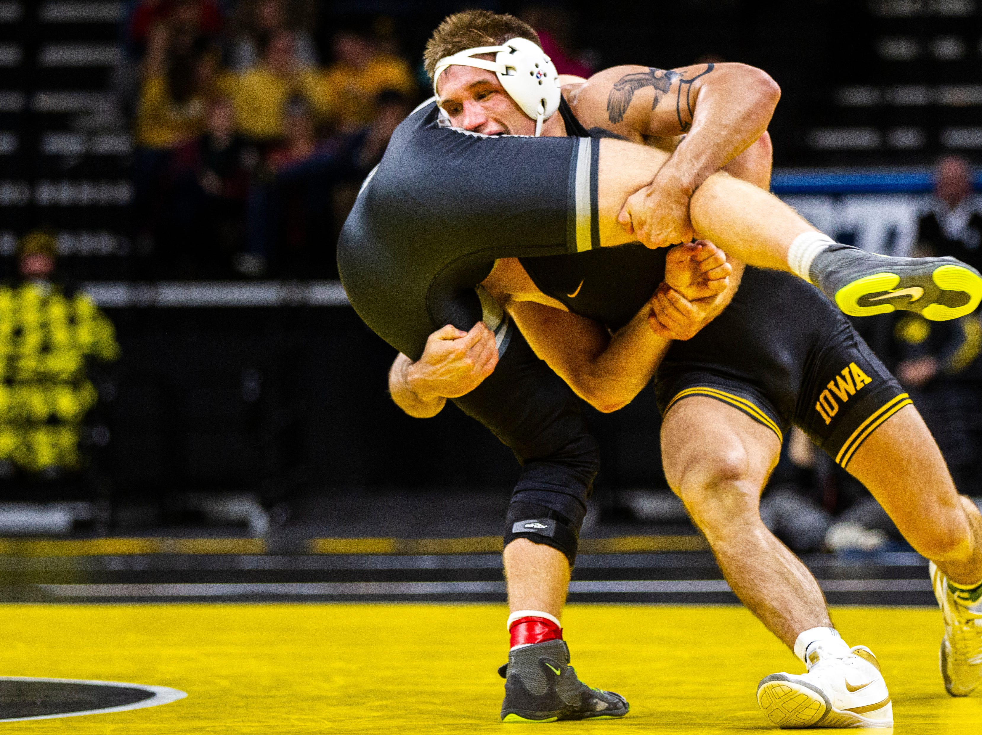 Iowa's Cash Wilcke (right) wrestles Purdue's Max Lyon at 184 during a Big Ten Conference NCAA wrestling dual on Saturday, Nov. 24, 2018, at Carver-Hawkeye Arena in Iowa City.