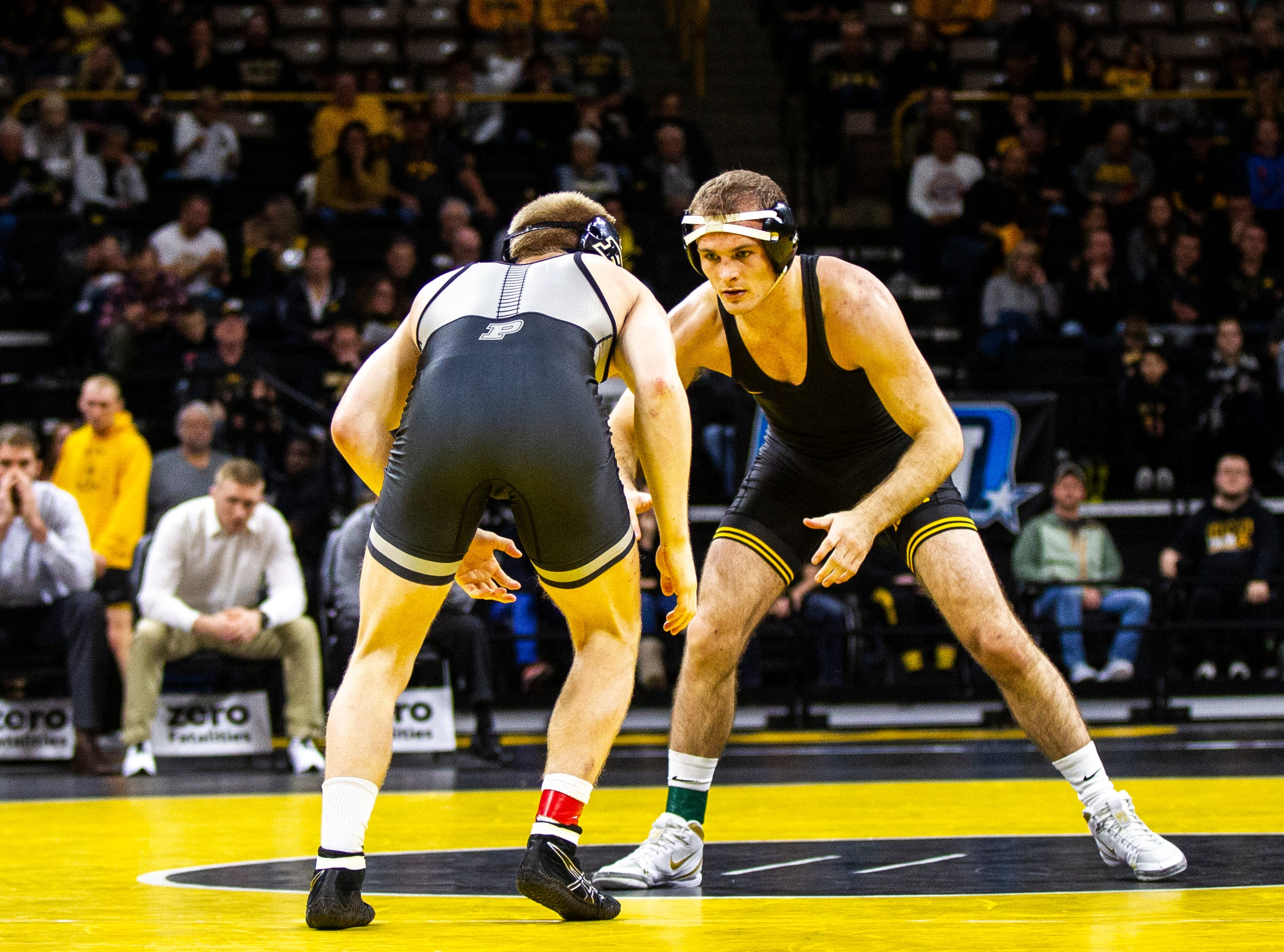 Iowa's Carter Happel (right) wrestles Purdue's Parker Filius at 149 during a Big Ten Conference NCAA wrestling dual on Saturday, Nov. 24, 2018, at Carver-Hawkeye Arena in Iowa City.