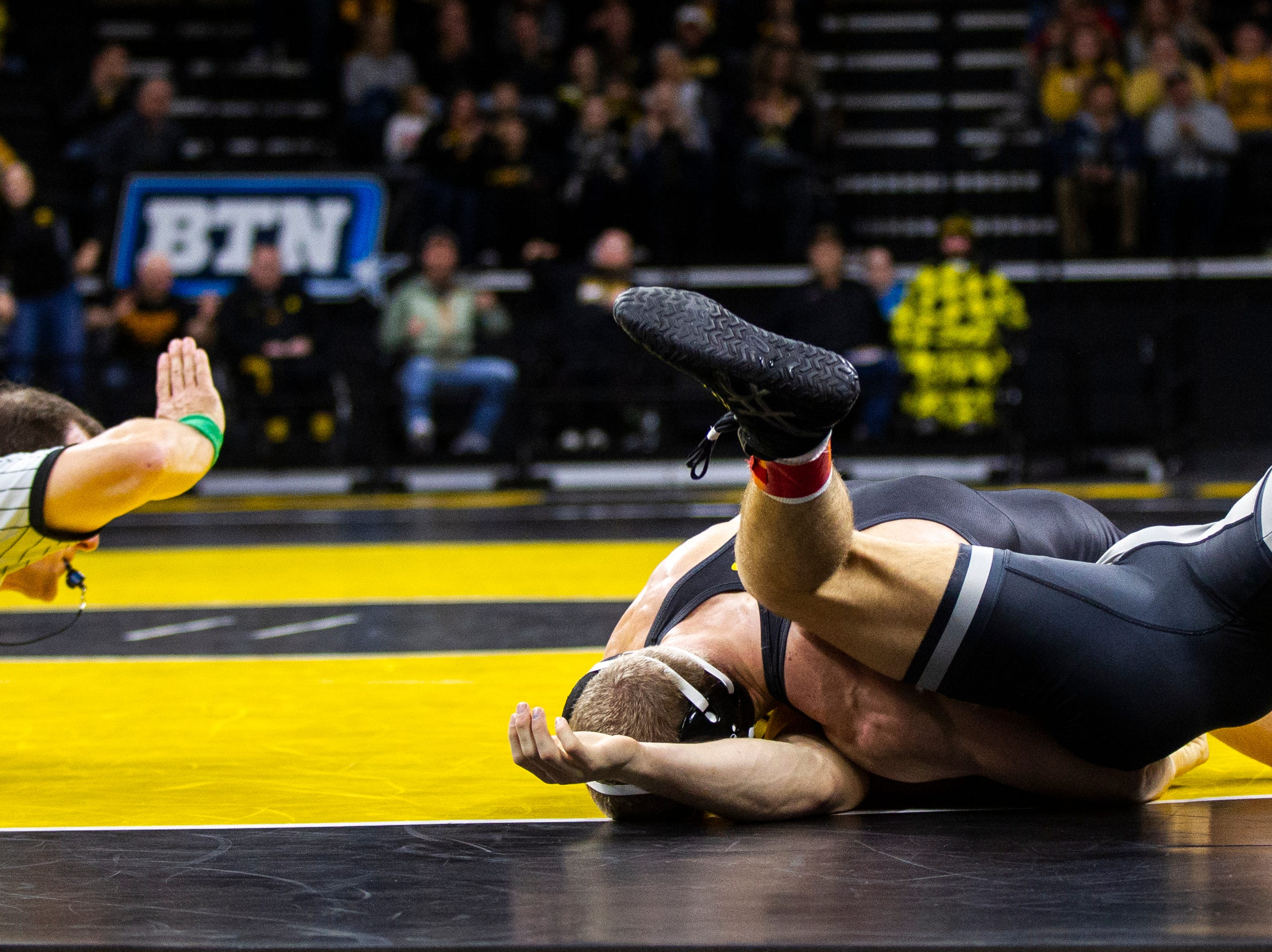 Iowa's Kaleb Young pins Purdue's Griffin Parriott at 157 during a Big Ten Conference NCAA wrestling dual on Saturday, Nov. 24, 2018, at Carver-Hawkeye Arena in Iowa City.
