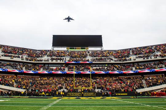A C-17 from the 87th Air Base Wing flies over the stadium before kickoff of last season's Iowa-Nebraska game at Kinnick Stadium.