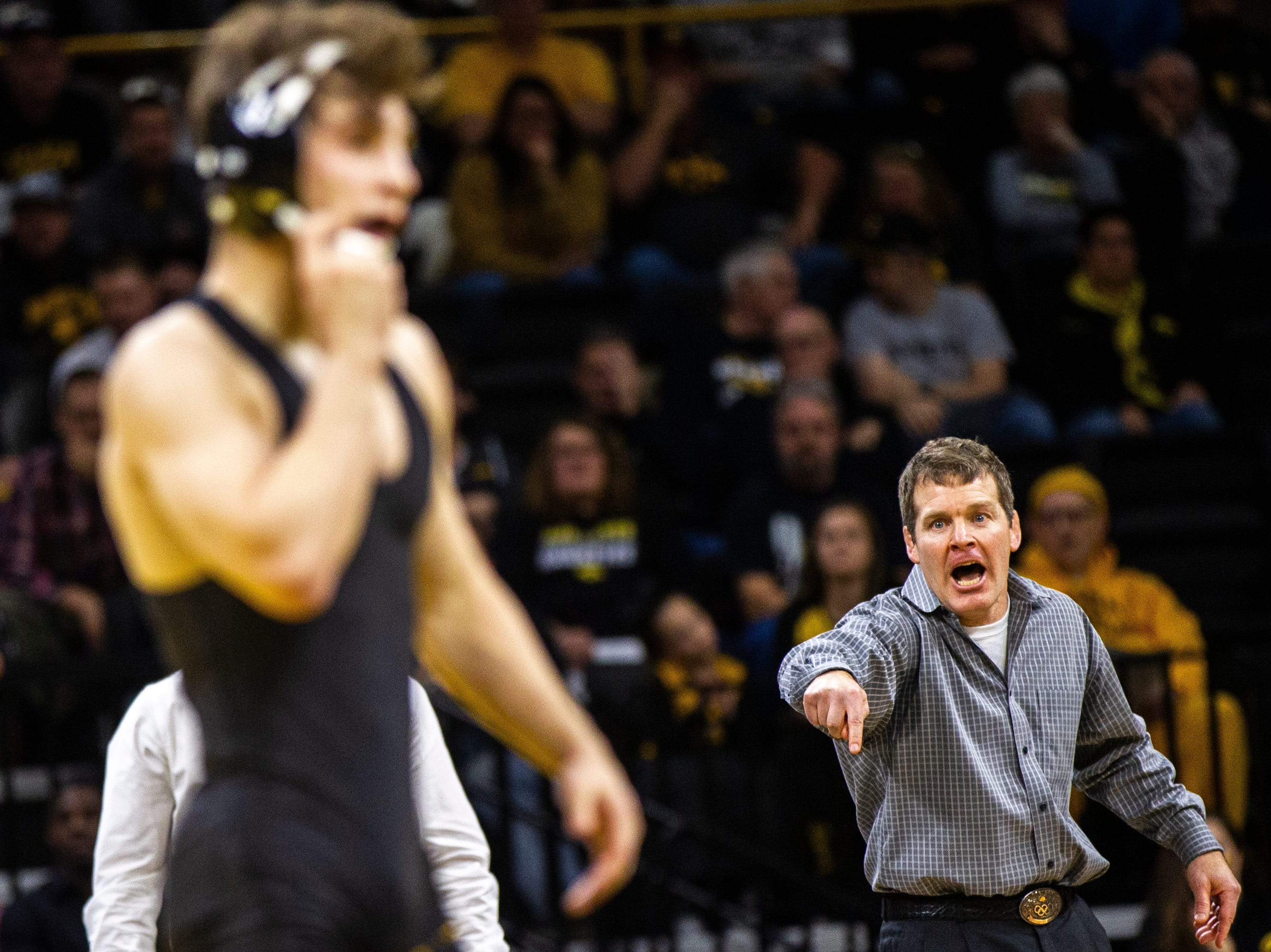 Iowa head coach Tom Brands calls out to Austin DeSanto during his match at 133 during a Big Ten Conference NCAA wrestling dual on Saturday, Nov. 24, 2018, at Carver-Hawkeye Arena in Iowa City.