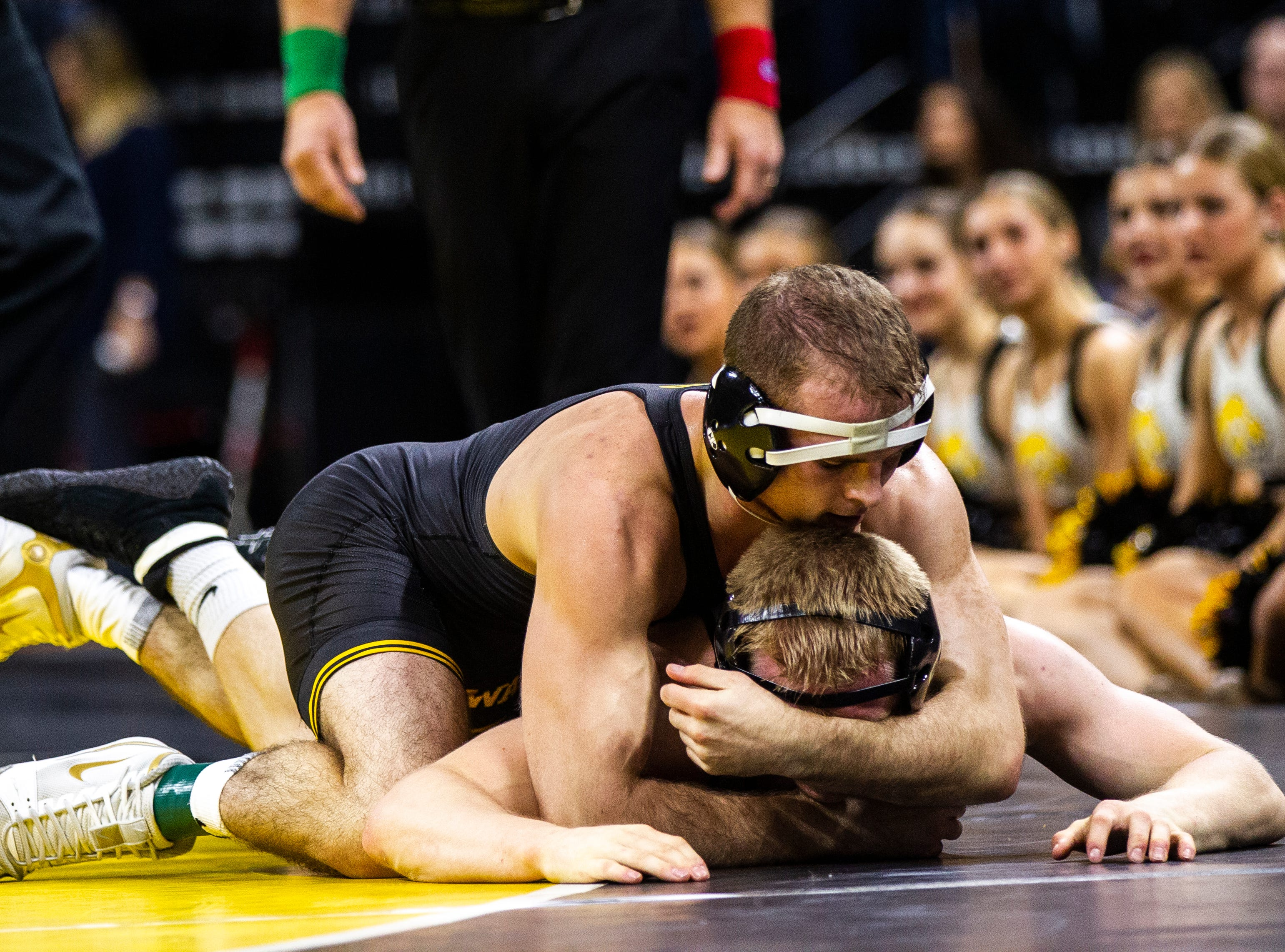 Iowa's Carter Happel (top) wrestles Purdue's Parker Filius at 149 during a Big Ten Conference NCAA wrestling dual on Saturday, Nov. 24, 2018, at Carver-Hawkeye Arena in Iowa City.