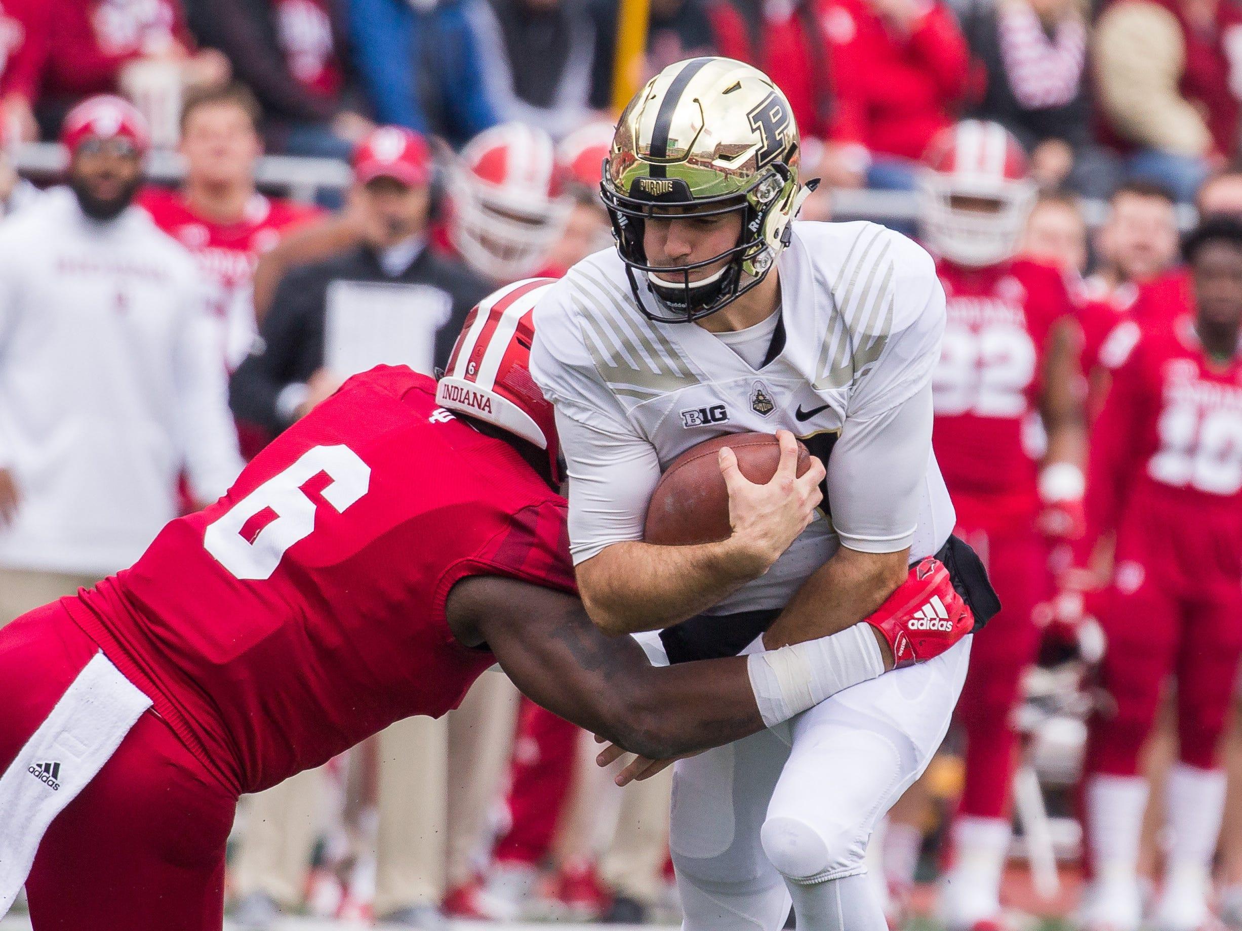 Purdue Boilermakers quarterback David Blough (11) is tackled by Indiana Hoosiers defensive lineman James Head Jr. (6) in the first quarter at Memorial Stadium.