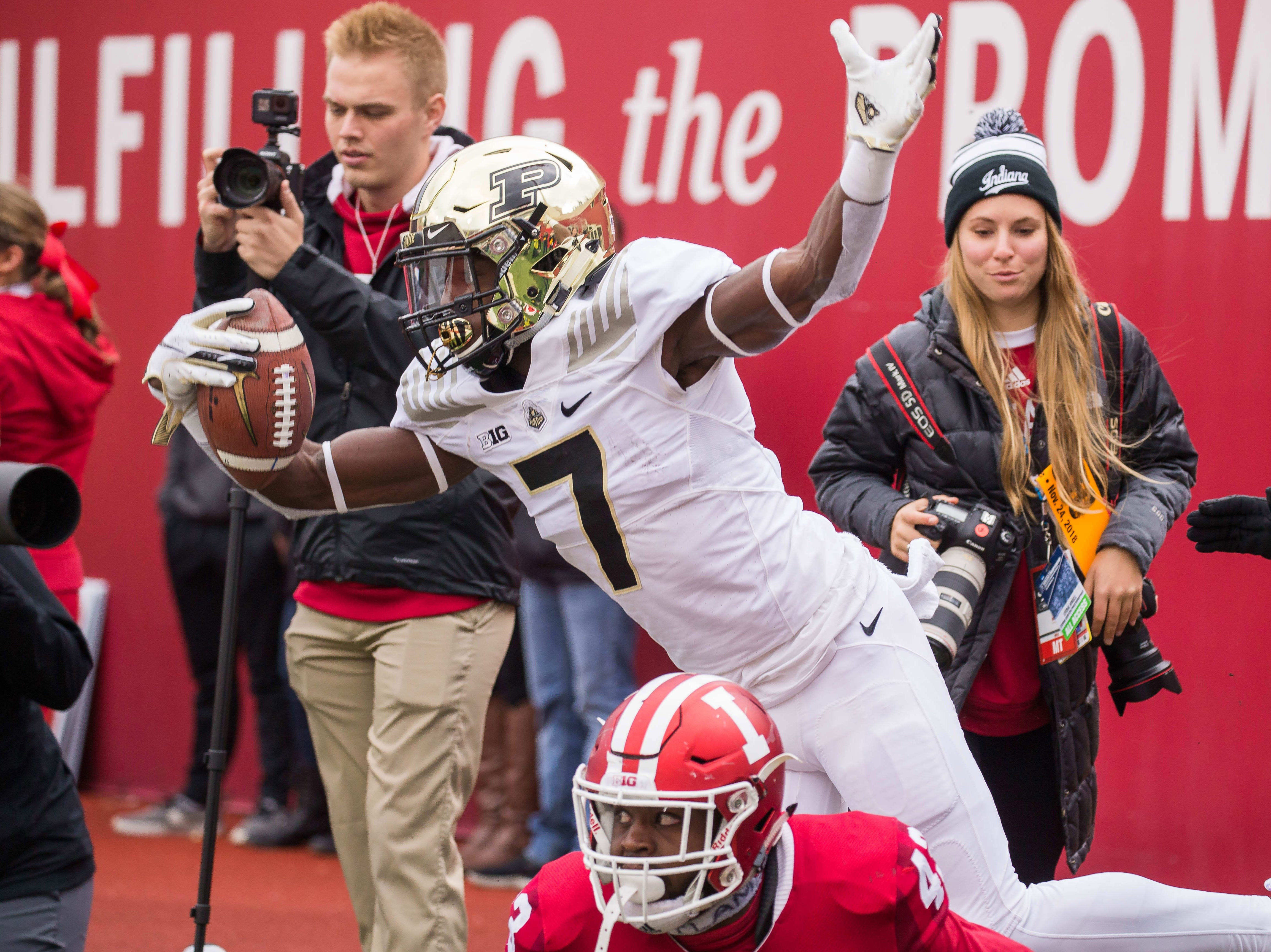Purdue Boilermakers wide receiver Isaac Zico (7) celebrates after scoring a touchdown against Indiana Hoosiers linebacker Dameon Willis Jr. (43) in the first quarter at Memorial Stadium.