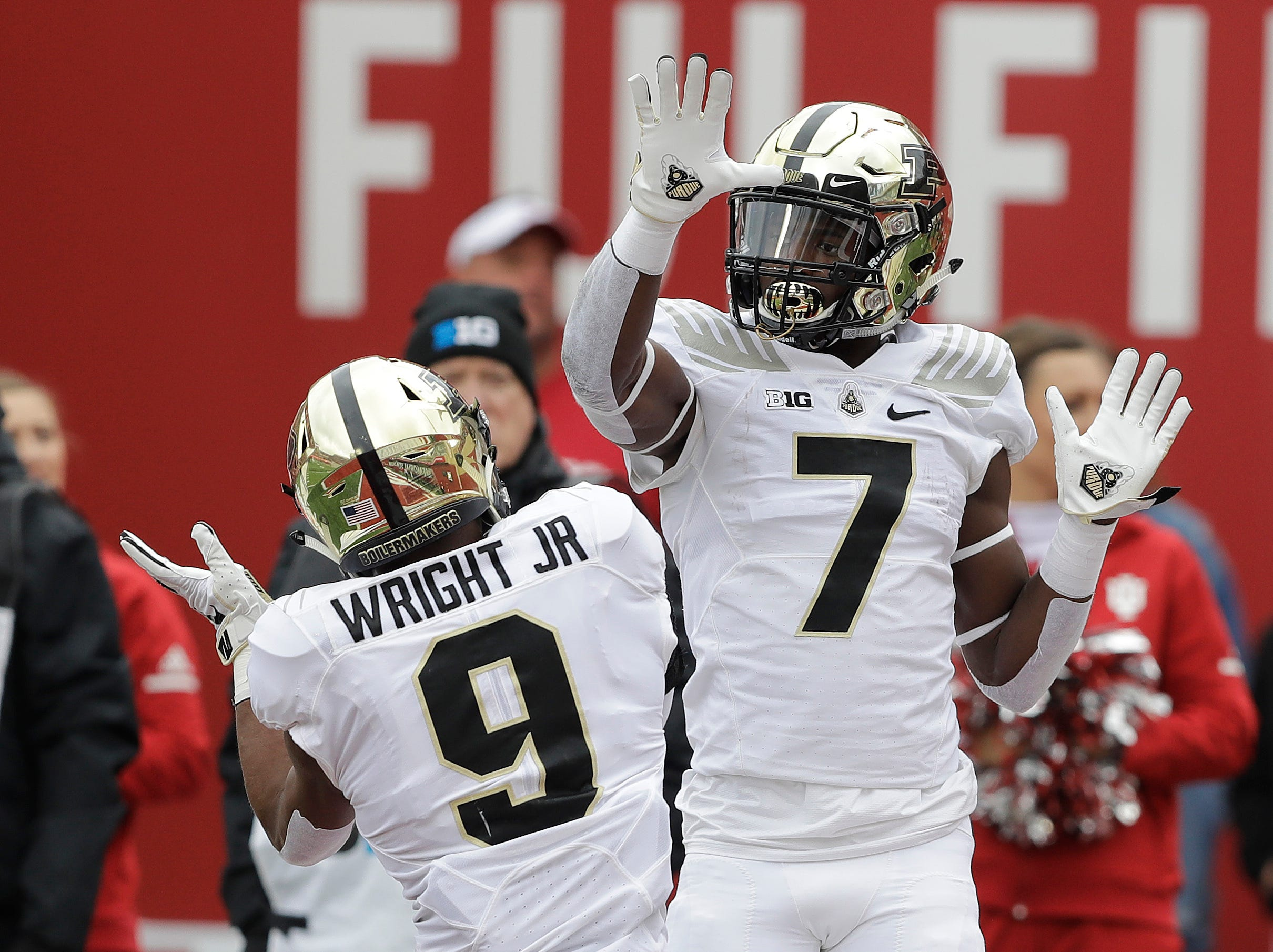 Purdue wide receiver Isaac Zico (7) celebrates a touchdown reception with Terry Wright during the first half of an NCAA college football game against Indiana, Saturday, Nov. 24, 2018, in Bloomington, Ind. (AP Photo/Darron Cummings)