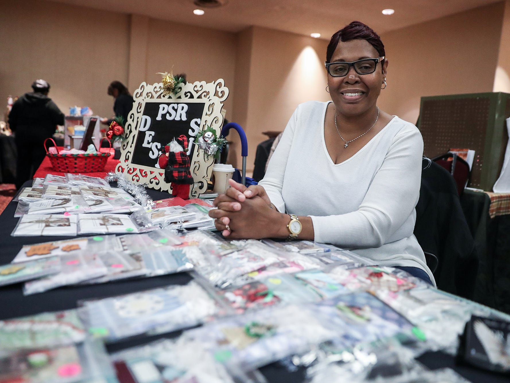 Pauline Ray sells hand-designed notebooks and notepads at a market showcasing more than 65 women and minority-owned small businesses at the Murat Shrine Temple in Indianapolis, Saturday, Nov. 24, 2018. The fifth annual event is part of Small Business Saturday, launched nationally by American Express eight years ago to help independently owned businesses bounce back from the recession.