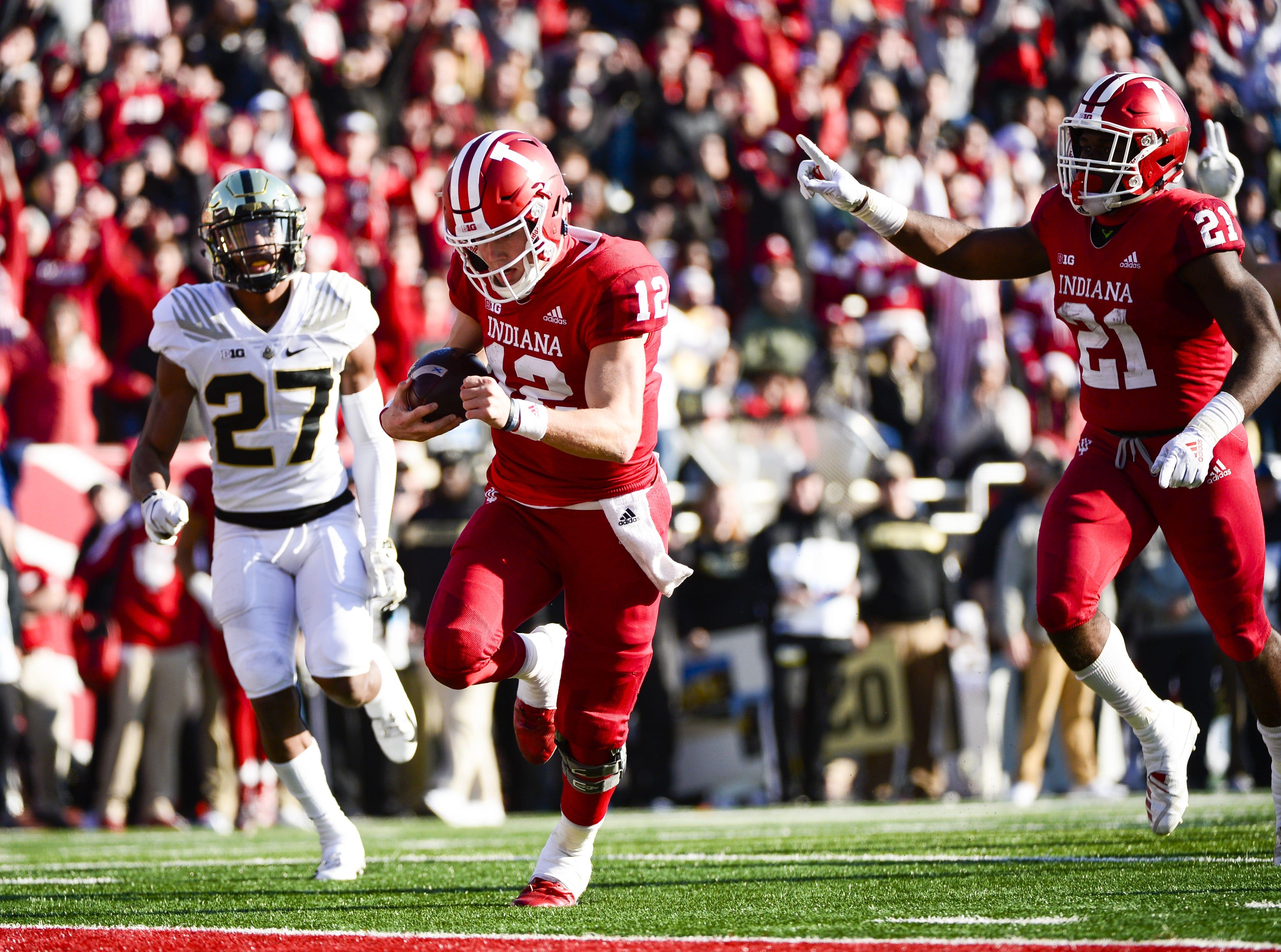 Indiana Hoosiers quarterback Peyton Ramsey (12) scores a touchdown during the game against Purdue at Memorial Stadium in Bloomington Ind., on Saturday, Nov. 24, 2018.