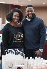 Marla and James Lewis, of Carmel, sell their Grow Bar Organics hair and beard care products at a market showcasing more than 65 women and minority-owned small businesses Saturday at the Murat Shrine Temple in Indianapolis.