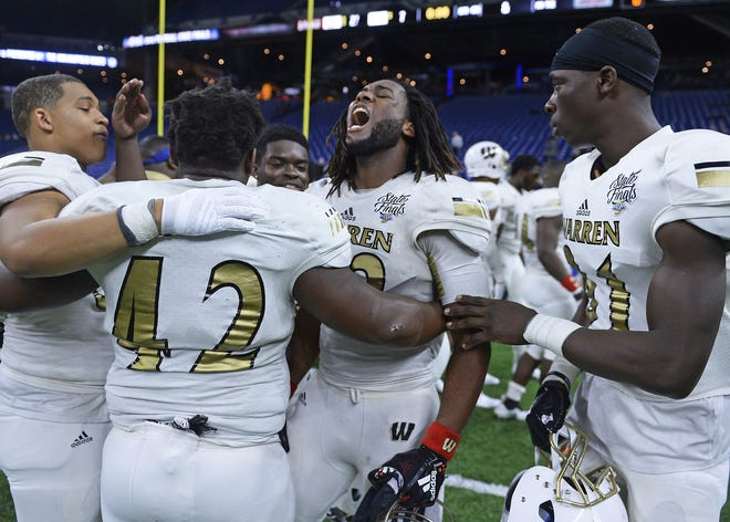 Warren Central's middle linebacker Kavie Minor (32) celebrates with his team after defeating Carmel in the IHSAA Class 6A state final game at Lucas Oil Stadium in Indianapolis, Ind., Friday, Nov. 23, 2018. Warren Central defeated Carmel 27-7 for the state title.