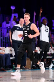 Butler Bulldogs guard Paul Jorgensen (5) reacts after scoring during the first half against the Florida Gators at Imperial Arena.