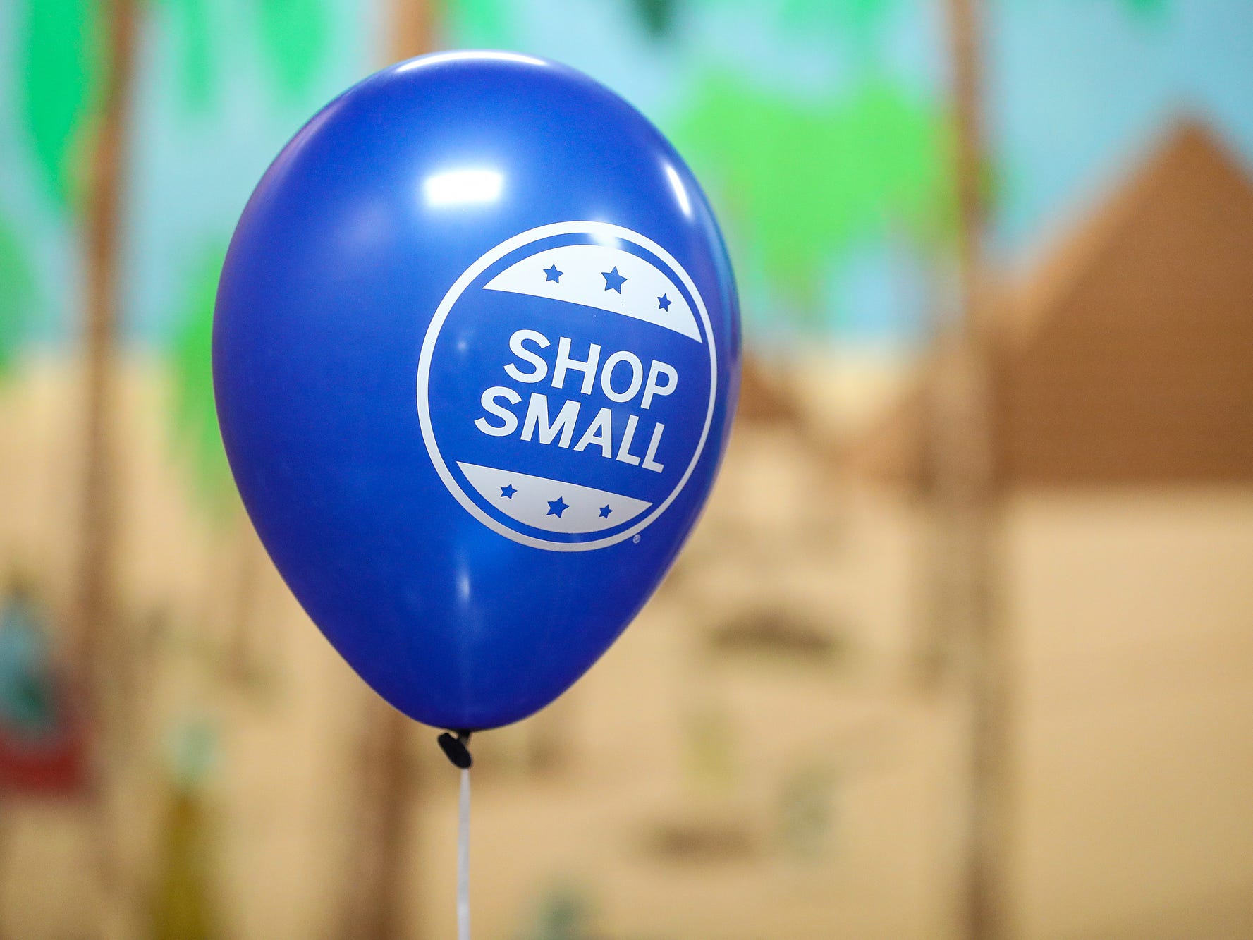 A balloon floats at a market showcasing more than 65 women and minority-owned small businesses at the Murat Shrine Temple in Indianapolis, Saturday, Nov. 24, 2018. The fifth annual event is part of Small Business Saturday, launched nationally by American Express eight years ago to help independently owned businesses bounce back from the recession.