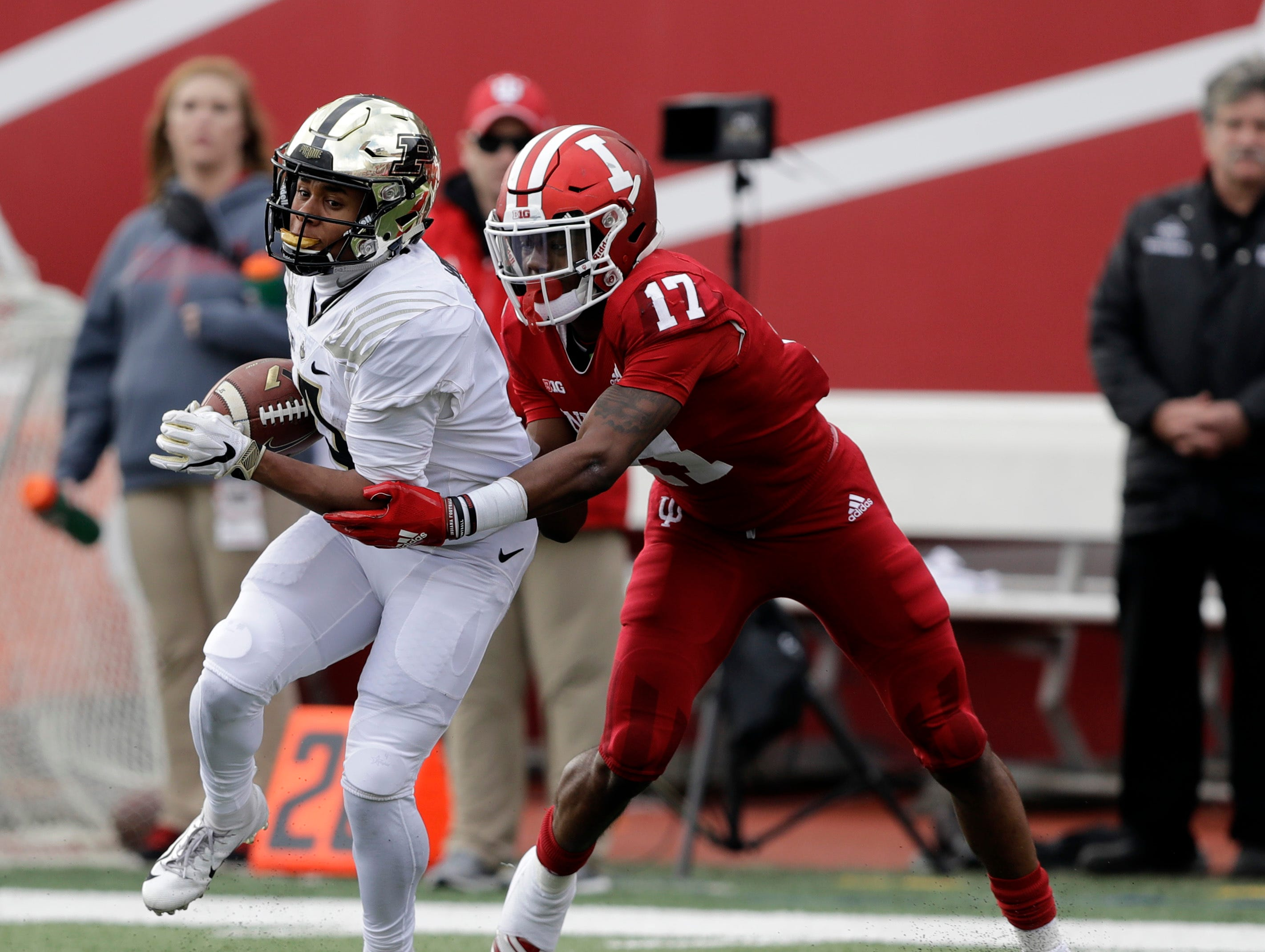 Purdue's Rondale Moore (4) runs out of the tackle of Indiana's Raheem Layne for a touchdown during the first half of an NCAA college football game, Saturday, Nov. 24, 2018, in Bloomington, Ind. (AP Photo/Darron Cummings)