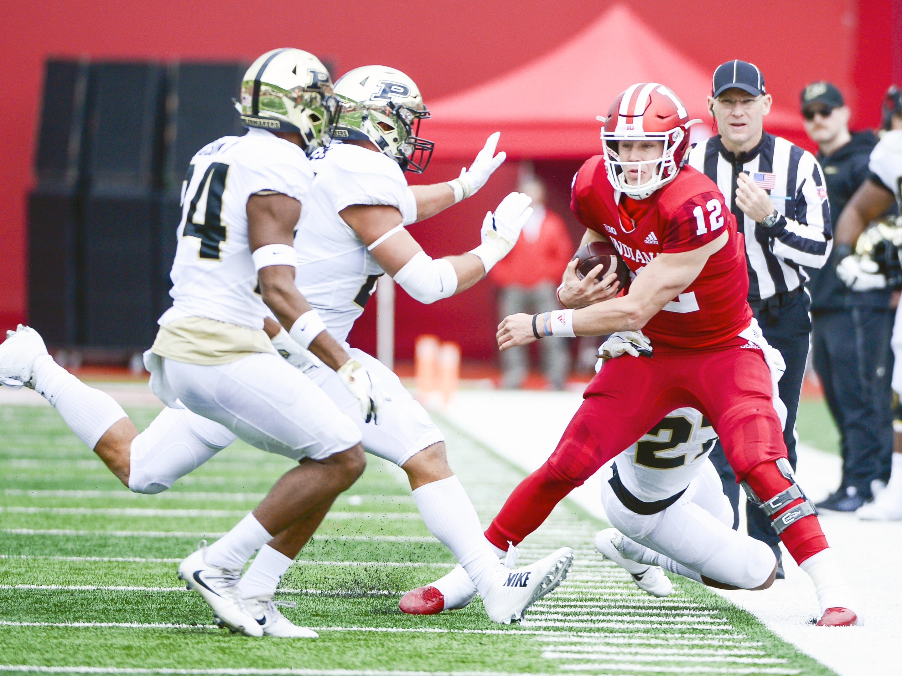 Indiana Hoosiers quarterback Peyton Ramsey (12) is pushed out of bounds during the game against Purdue at Memorial Stadium in Bloomington Ind., on Saturday, Nov. 24, 2018.