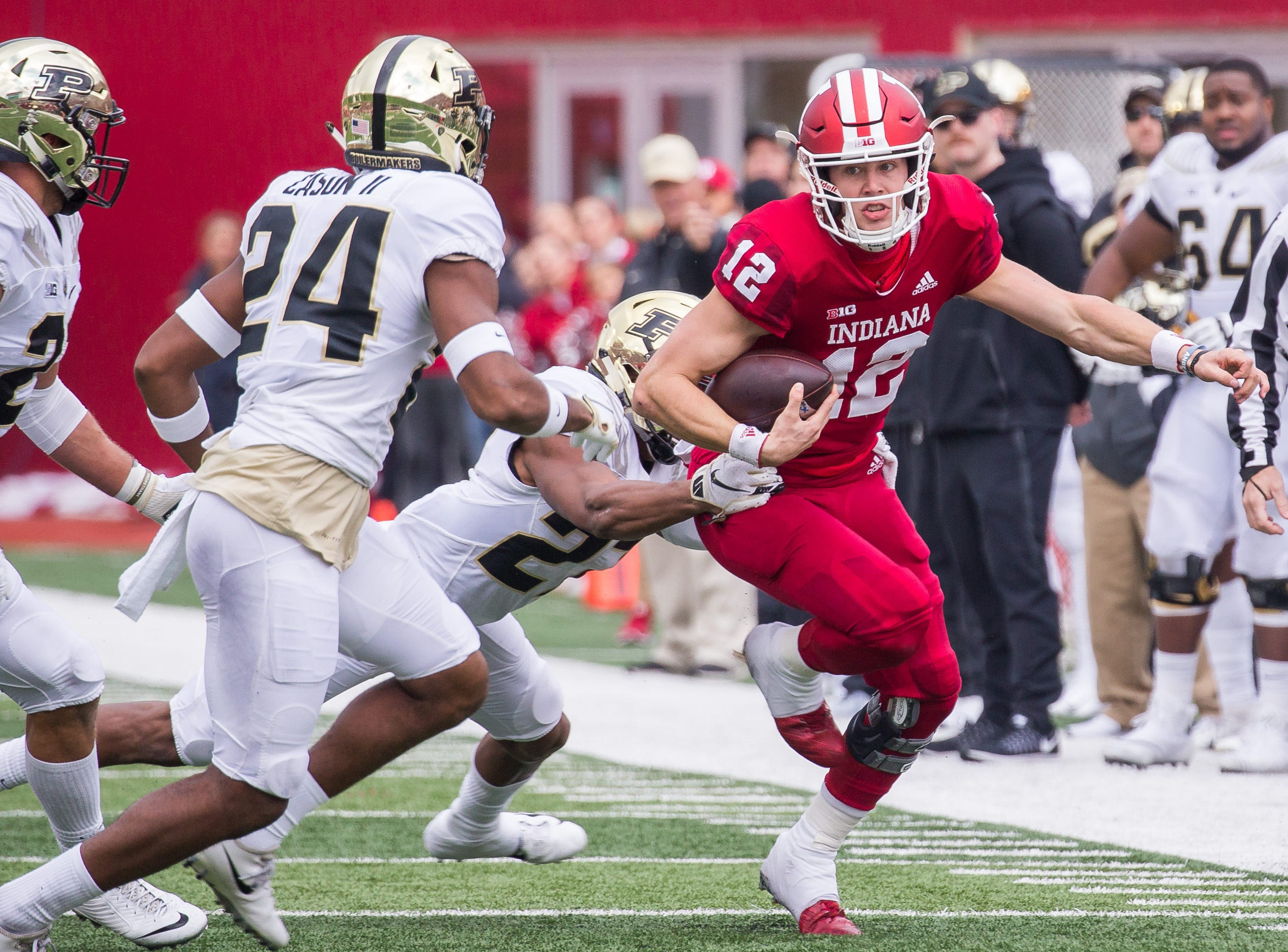 Indiana Hoosiers quarterback Peyton Ramsey (12) is tackled by Purdue Boilermakers safety Navon Mosley (27) in the first quarter at Memorial Stadium.