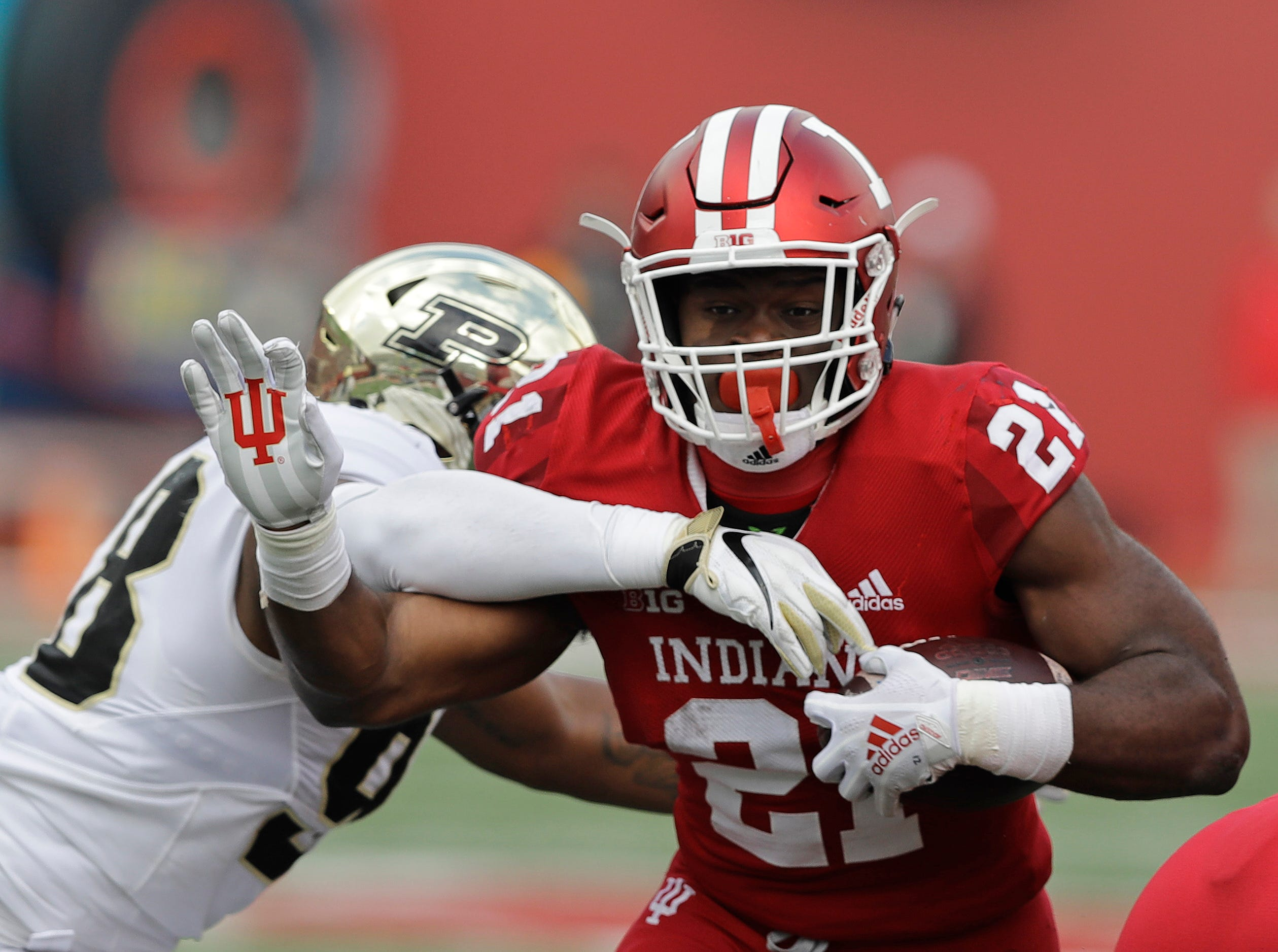 Indiana running back Stevie Scott (21) runs out of the tackle of Purdue's Kai Higgins during the first half of an NCAA college football game, Saturday, Nov. 24, 2018, in Bloomington, Ind. (AP Photo/Darron Cummings)