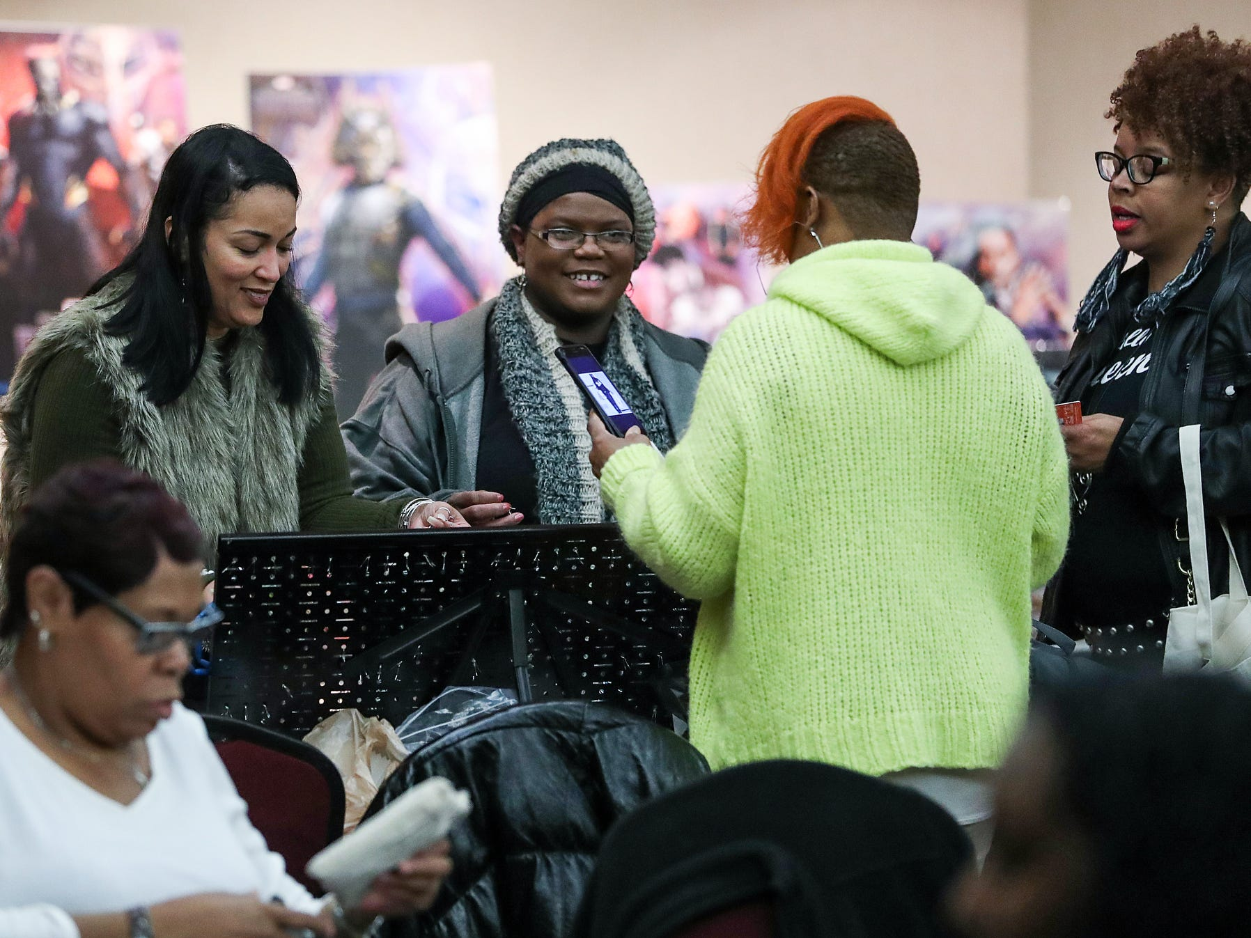 Shoppers browse a market showcasing more than 65 women and minority-owned small businesses at the Murat Shrine Temple in Indianapolis, Saturday, Nov. 24, 2018. The fifth annual event is part of Small Business Saturday, launched nationally by American Express eight years ago to help independently owned businesses bounce back from the recession.