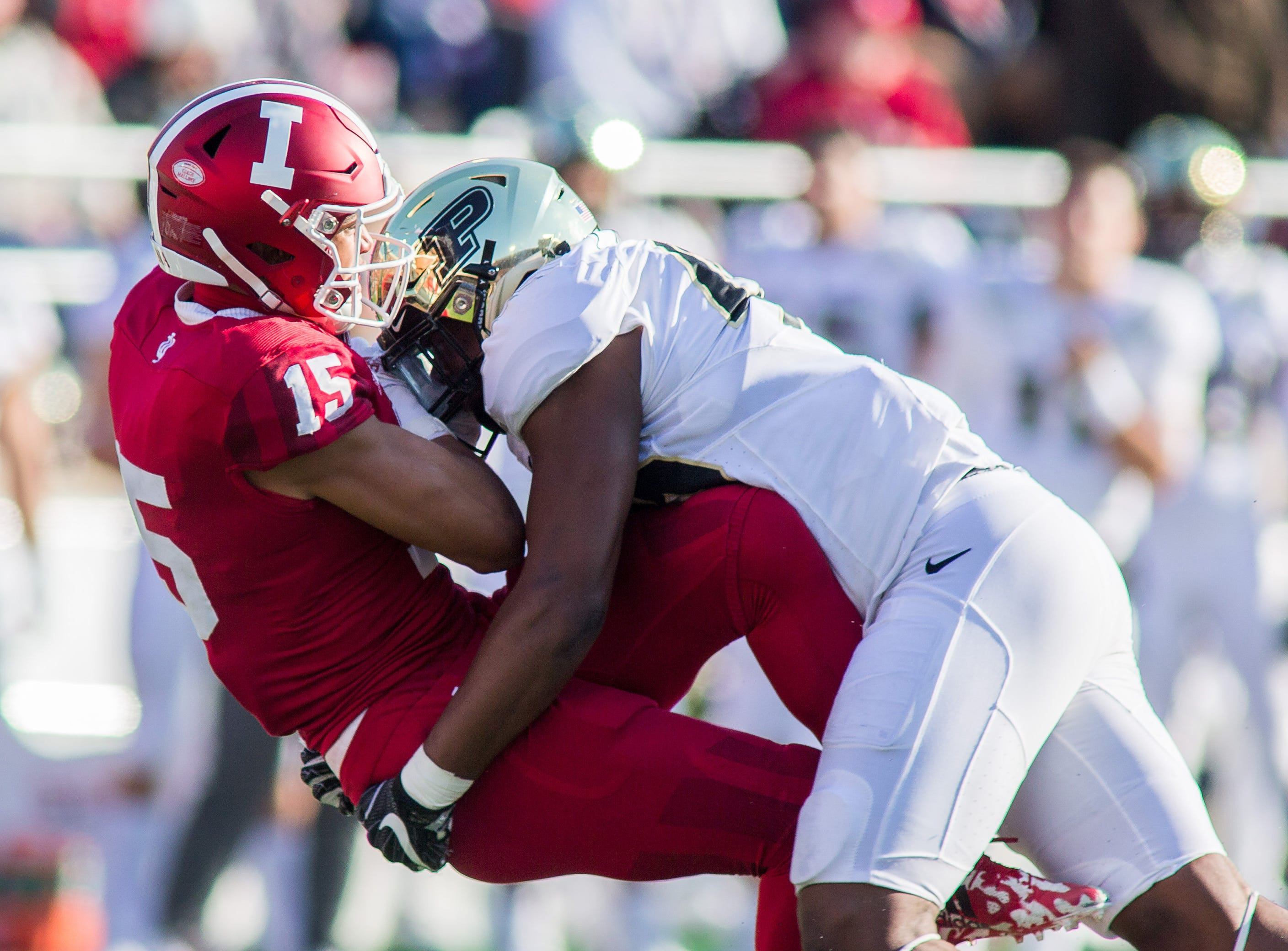 Purdue Boilermakers defensive tackle Anthony Watts (44) tackles Indiana Hoosiers wide receiver Nick Westbrook (15) in the second half at Memorial Stadium.