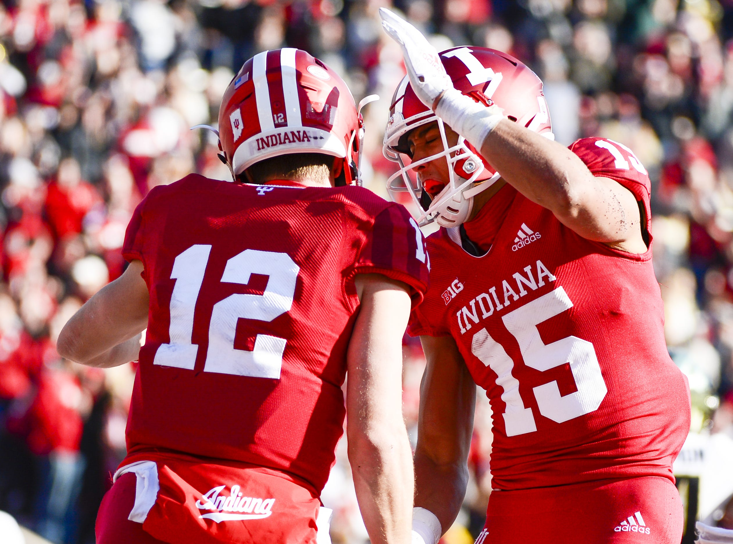 Indiana Hoosiers quarterback Peyton Ramsey (12) celebrates with wide receiver Nick Westbrook (15) during the game against Purdue at Memorial Stadium in Bloomington Ind., on Saturday, Nov. 24, 2018.