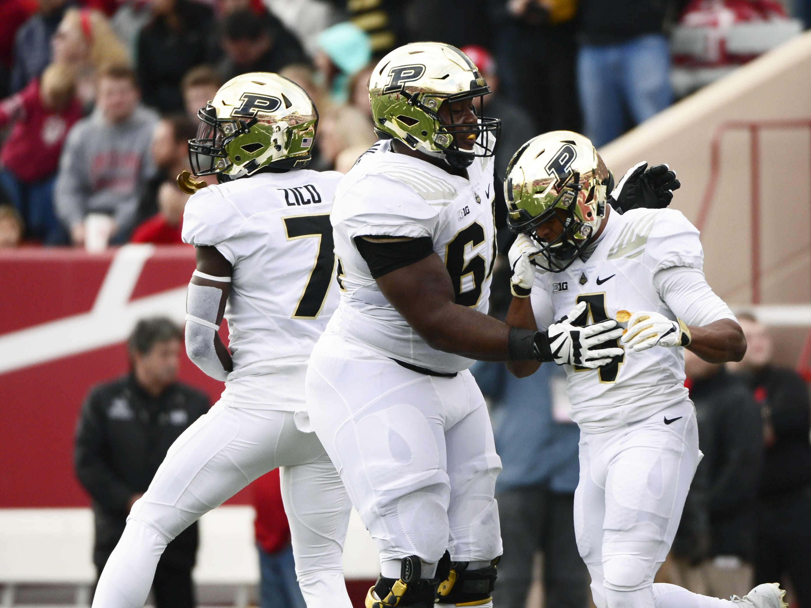 The Purdue Boilermakers celebrate after scoring a touchdown against Indiana during the game at Memorial Stadium in Bloomington Ind., on Saturday, Nov. 24, 2018.