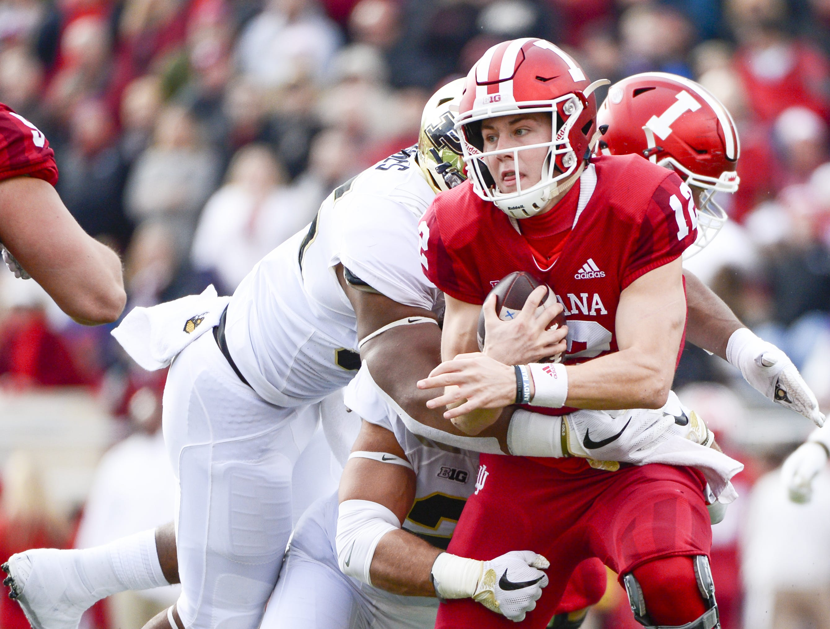Indiana Hoosiers quarterback Peyton Ramsey (12) is tackled during the game against Purdue at Memorial Stadium in Bloomington Ind., on Saturday, Nov. 24, 2018.