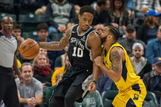 San Antonio Spurs guard DeMar DeRozan (10) dribbles the ball as  Indiana Pacers guard Cory Joseph (6) defends in the first half at Bankers Life Fieldhouse.