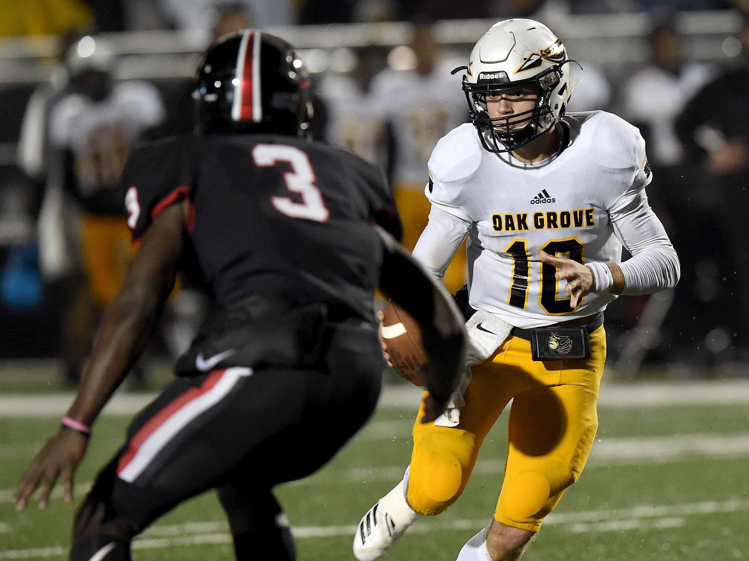 Oak Grove quarterback John Rhys Plumlee (10) runs the option against Brandon in the MHSAA Class 6A South State Championship on Friday, November 23, 2018, at Brandon High School in Brandon, Miss.