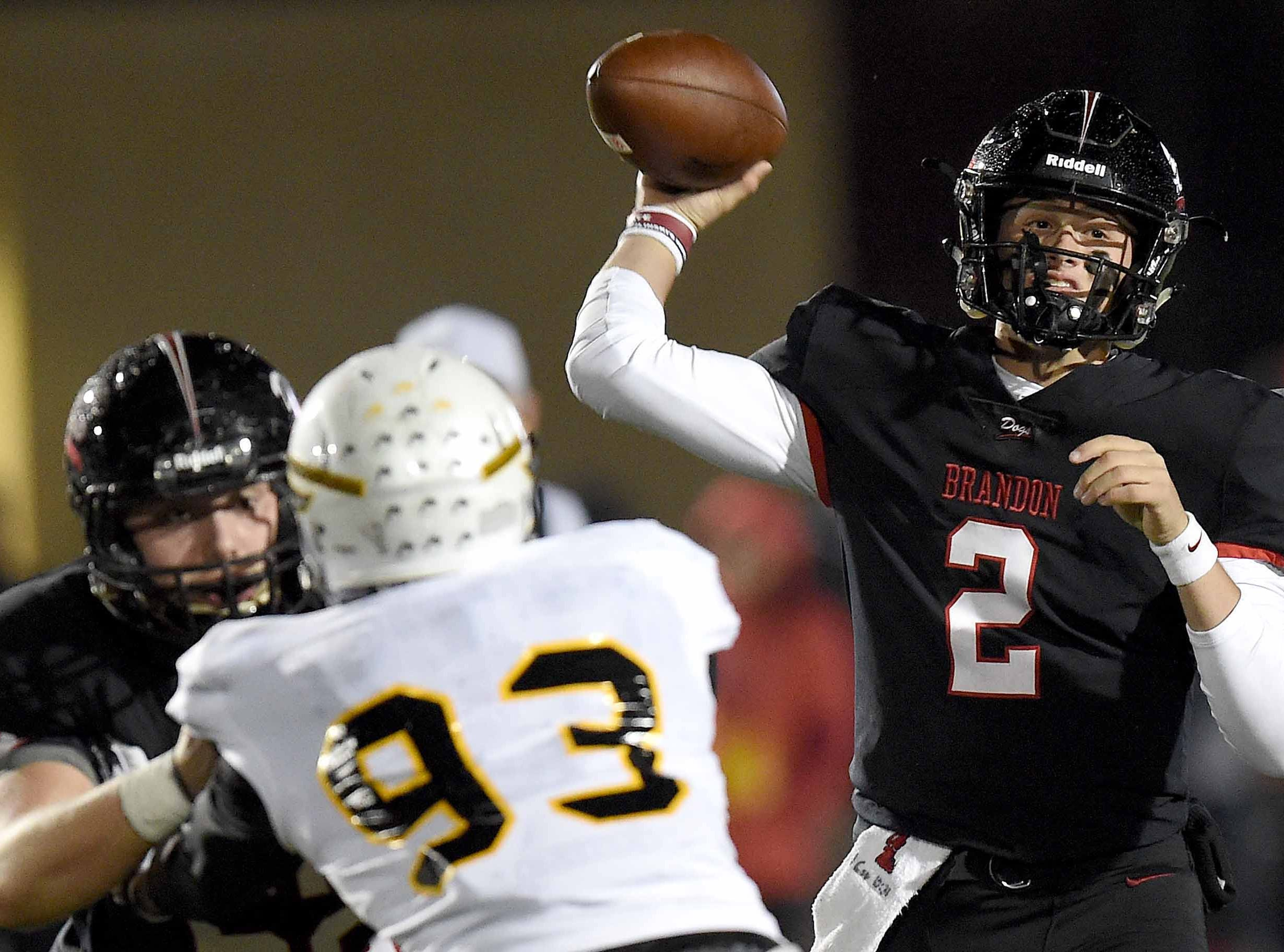 Brandon quarterback Will Rogers (2) throws over the Oak Grove pass rush the MHSAA Class 6A South State Championship on Friday, November 23, 2018, at Brandon High School in Brandon, Miss.