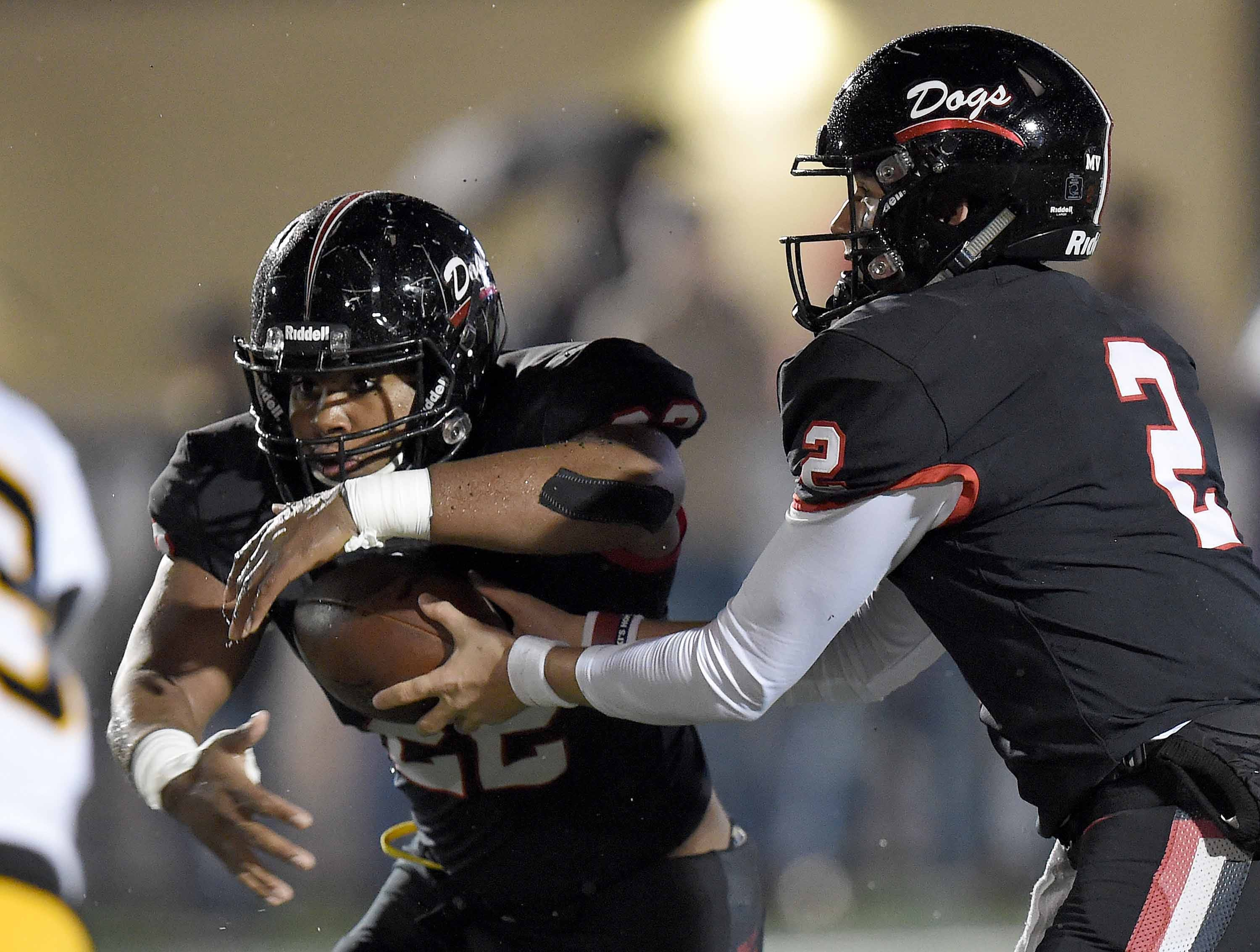 Brandon quarterback Will Rogers (2) hands off the Dallas Smith in the MHSAA Class 6A South State Championship on Friday, November 23, 2018, at Brandon High School in Brandon, Miss.
