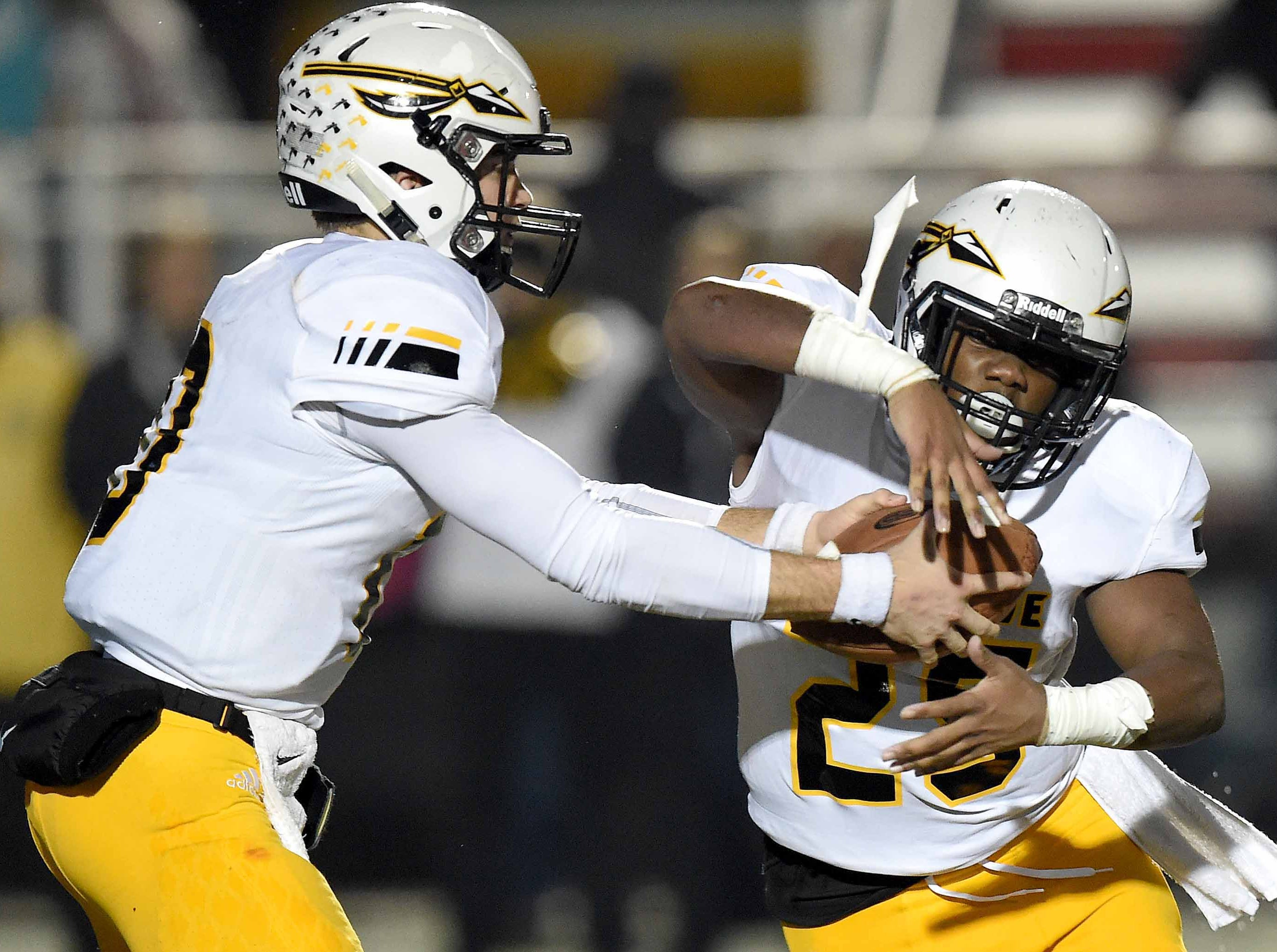 Oak Grove quarterback John Rhys Plumlee hands off to Rasaiah Ruffin (25) in the MHSAA Class 6A South State Championship on Friday, November 23, 2018, at Brandon High School in Brandon, Miss.