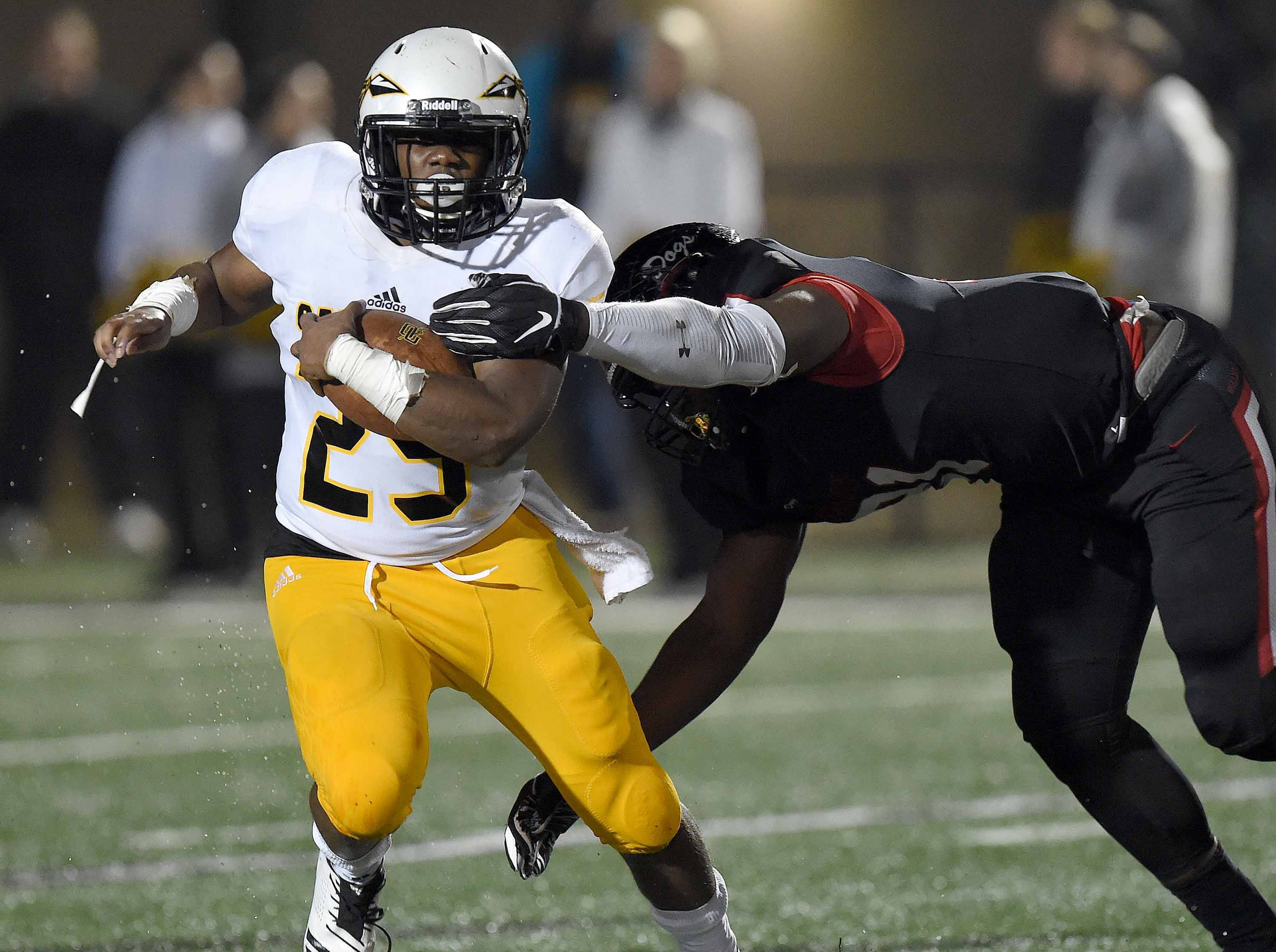 Oak Grov's Jarius Smith (25) runs against Brandon in the MHSAA Class 6A South State Championship on Friday, November 23, 2018, at Brandon High School in Brandon, Miss.