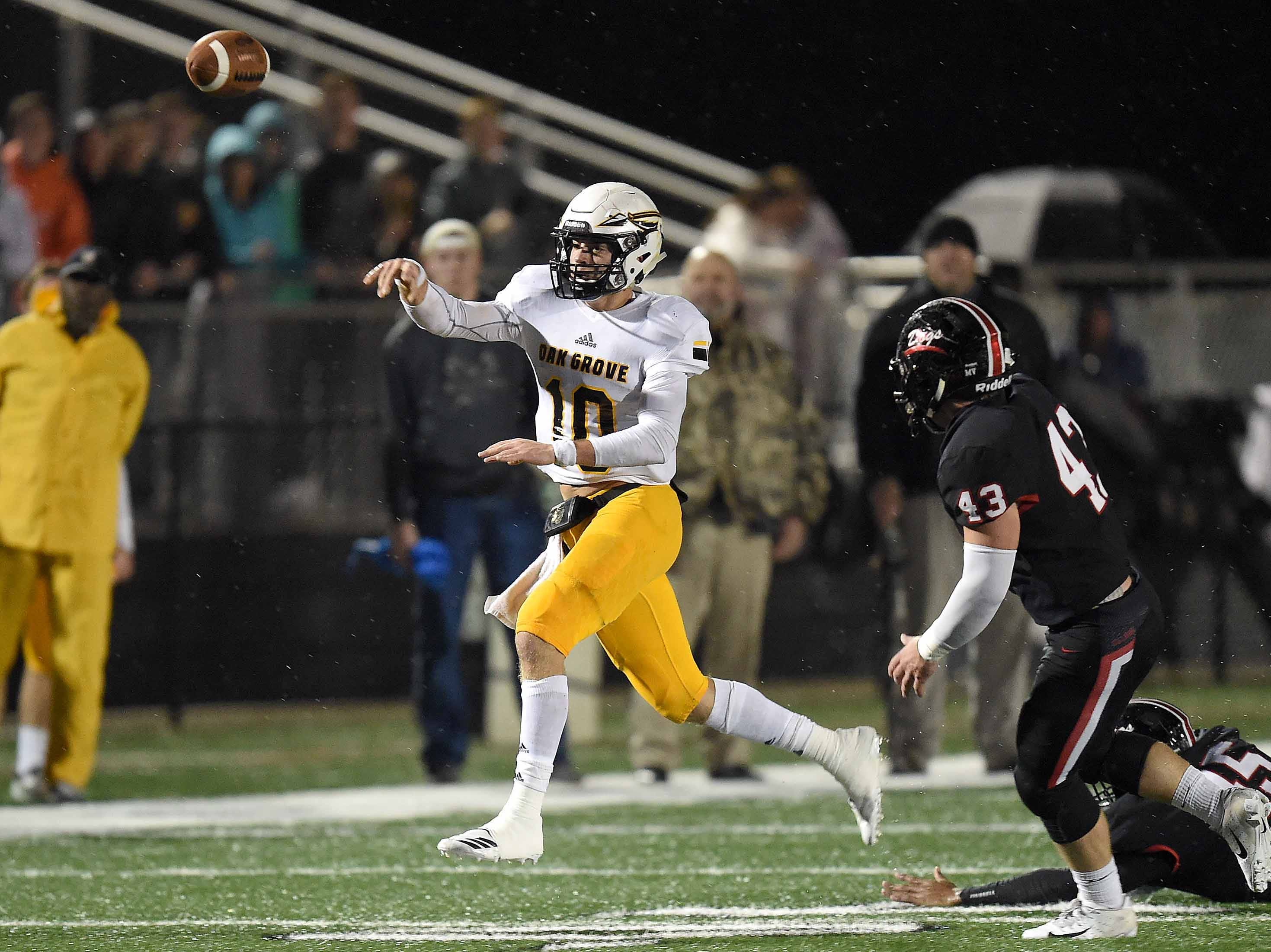Oak Grove quarterback John Rhys Plumlee (left) throws after scrambling against Brandon in the MHSAA Class 6A South State Championship on Friday, November 23, 2018, at Brandon High School in Brandon, Miss.