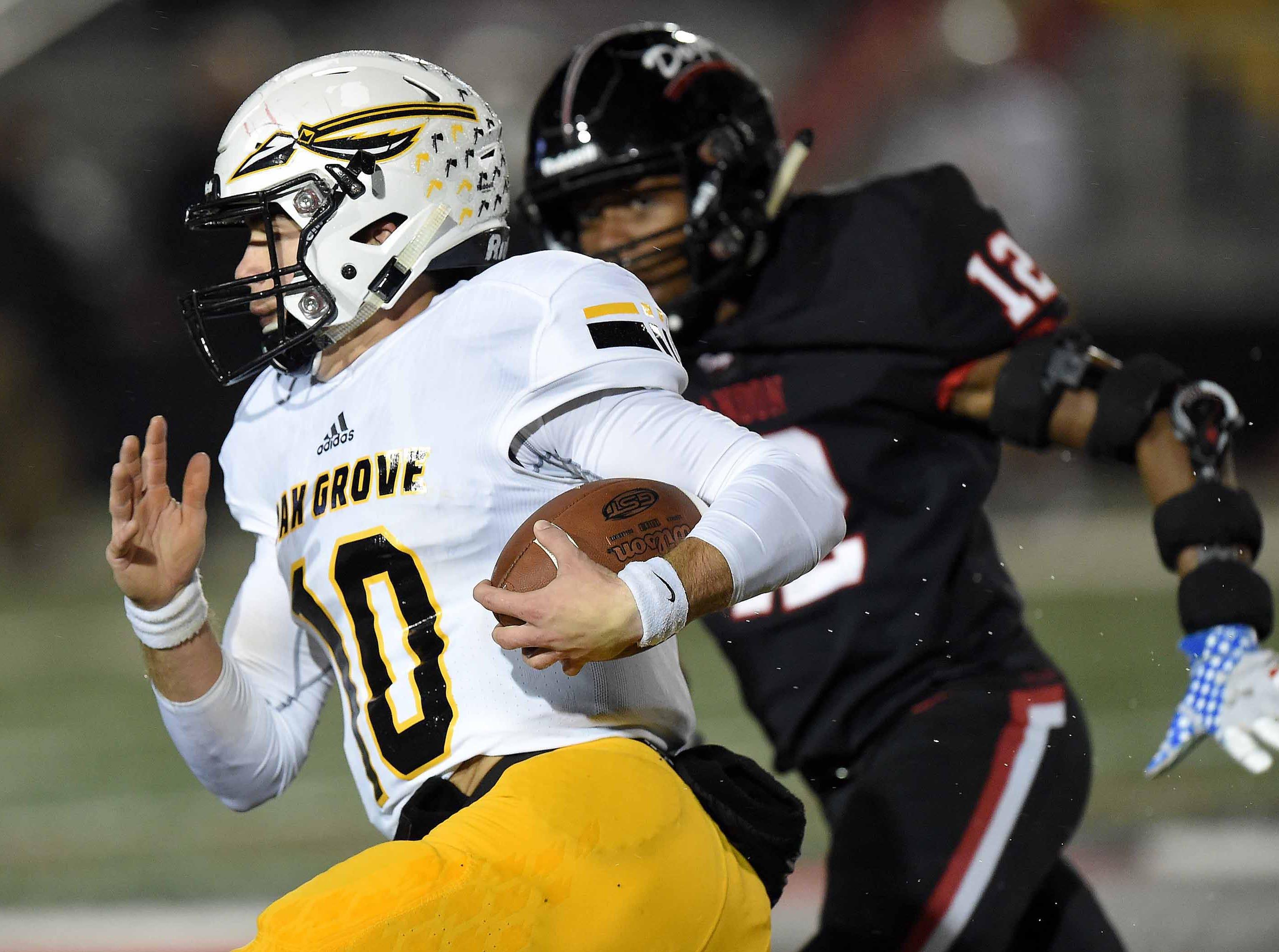 Oak Grove quarterback John Rhys Plumlee (10) runs against Brandon in the MHSAA Class 6A South State Championship on Friday, November 23, 2018, at Brandon High School in Brandon, Miss.