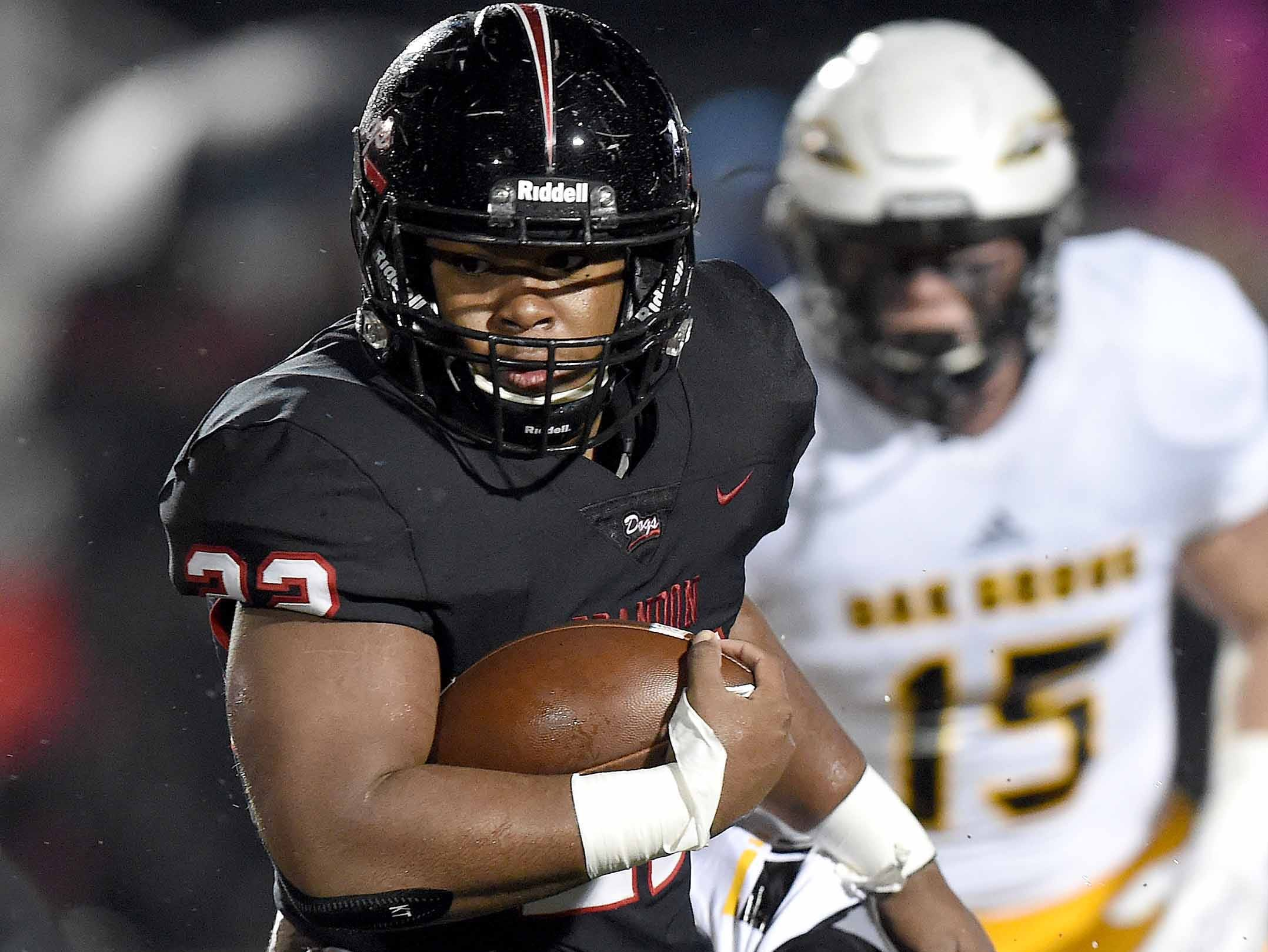 Brandon's Dallas Smith (22) runs against Oak Grove in the MHSAA Class 6A South State Championship on Friday, November 23, 2018, at Brandon High School in Brandon, Miss.