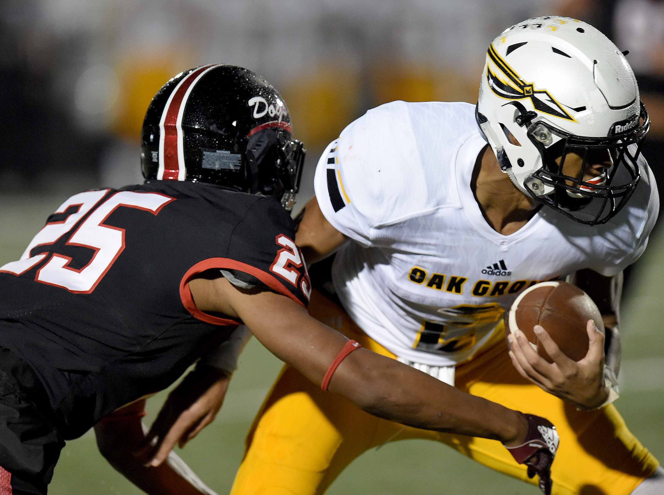 Oak Grove's Kevin Barnett (2) looks for additional yardage against Brandon in the MHSAA Class 6A South State Championship on Friday, November 23, 2018, at Brandon High School in Brandon, Miss.