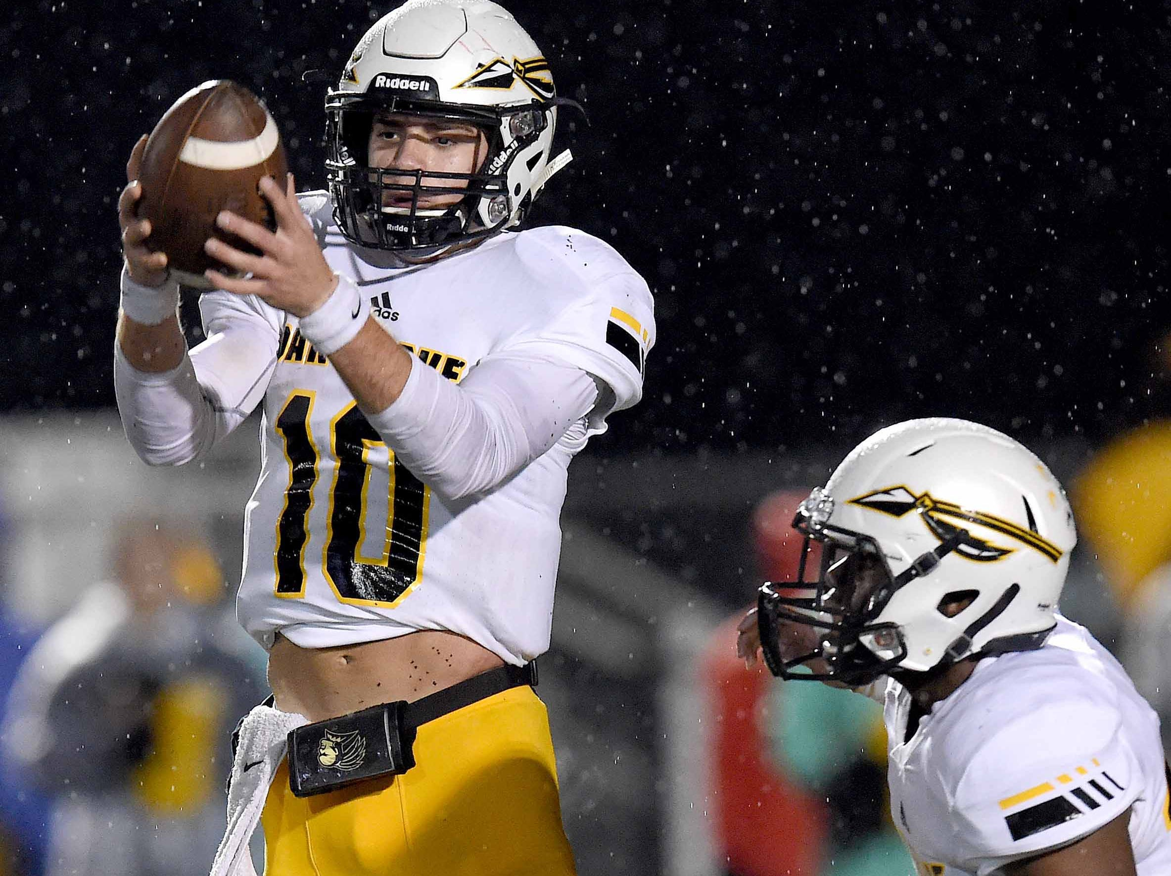 Oak Grove quarterback John Rhys Plumlee (10) catches one of the many high snaps during the first half of the MHSAA Class 6A South State Championship on Friday, November 23, 2018, at Brandon High School in Brandon, Miss.